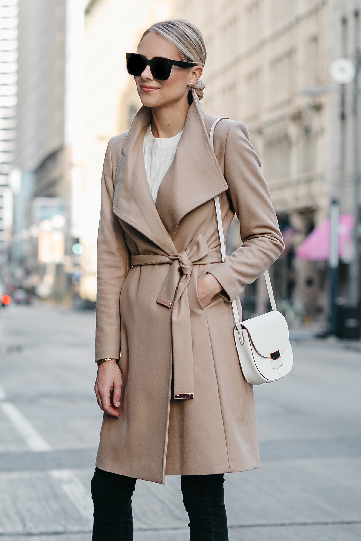 Blonde Woman Wearing Tan Wrap Coat Black Skinny Jeans Celine White Trotteur Handbag Fashion Jackson Dallas Blogger Fashion Blogger Street Style