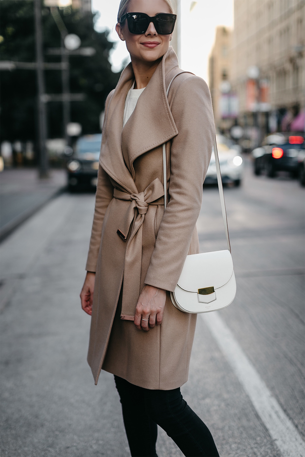 Blonde Woman Wearing Tan Wrap Coat Celine White Trotteur Handbag Black Skinny Jeans Fashion Jackson Dallas Blogger Fashion Blogger Street Style