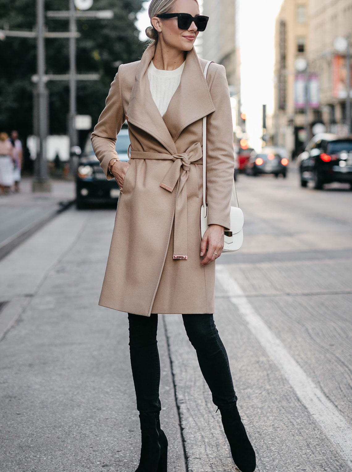 Blonde Woman Wearing Tan Wrap Coat White Sweater Black Skinny Jeans Black Booties Outfit Fashion Jackson Dallas Blogger Fashion Blogger Street Style