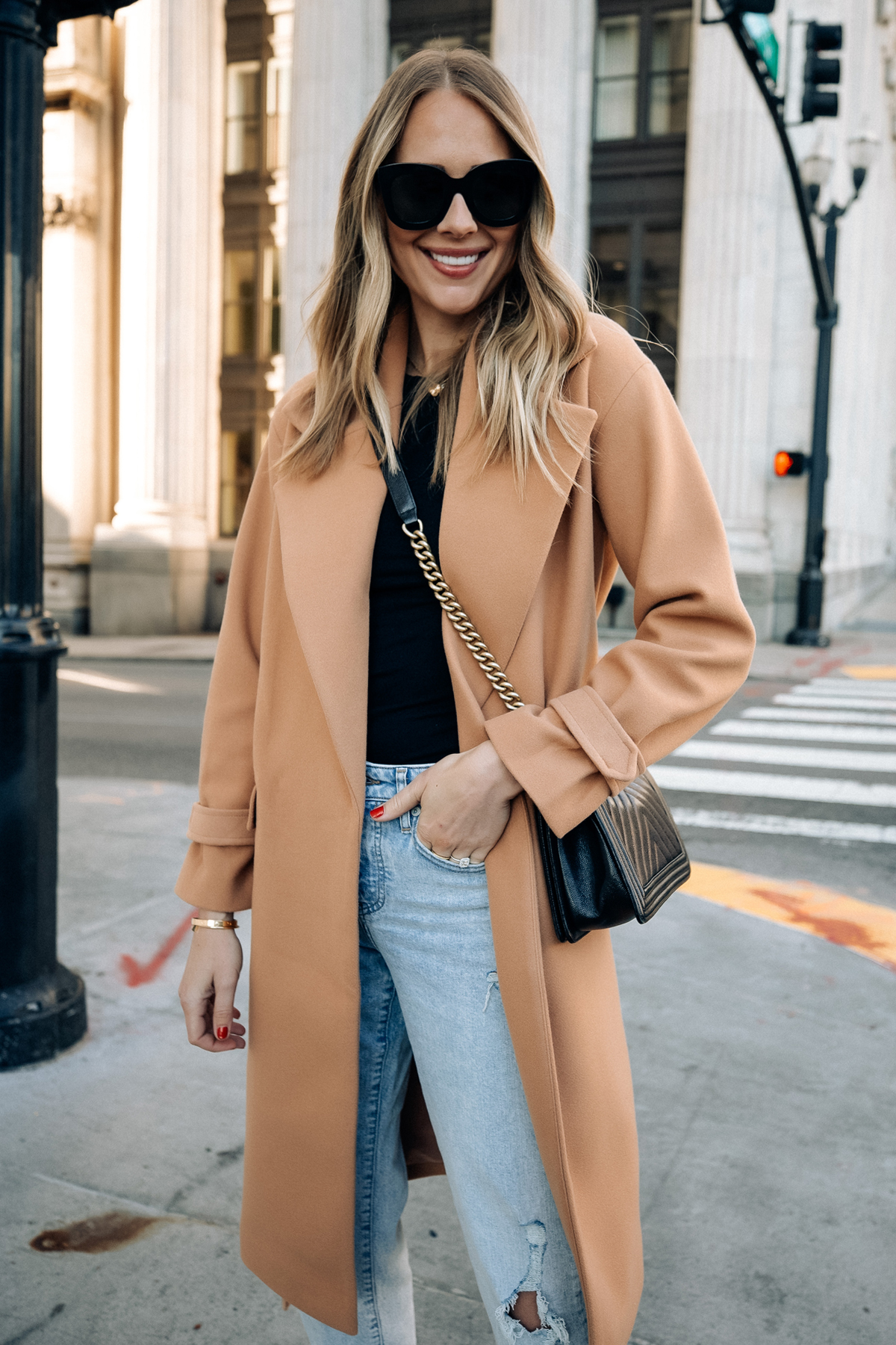 Fashion Jackson Wearing Express Camel Coat Black Tee Ripped Jeans Black Handbag Fall Outfit 1