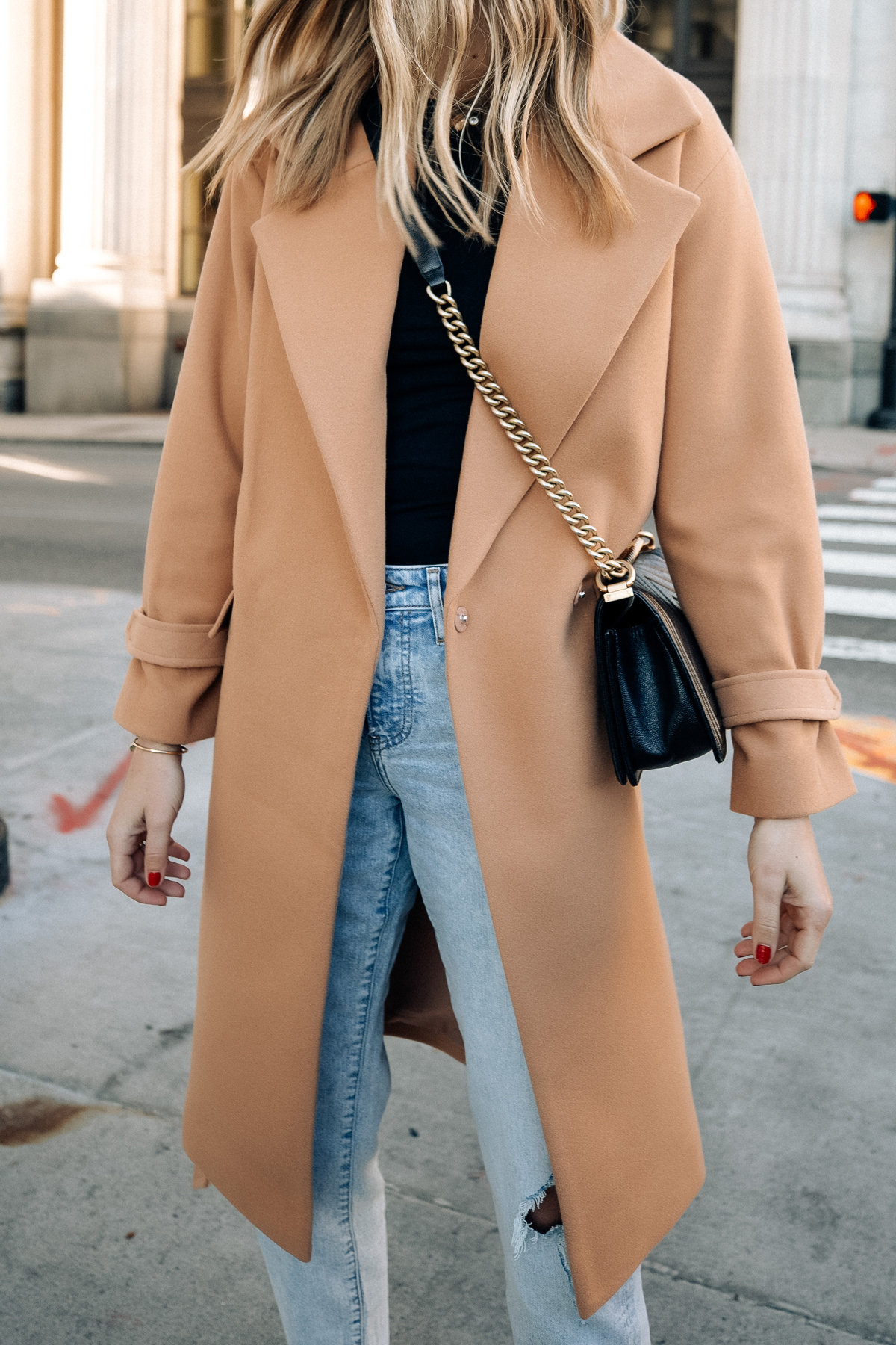 Fashion Jackson Wearing Express Camel Coat Black Tee Ripped Jeans Black Handbag Fall Outfit 2