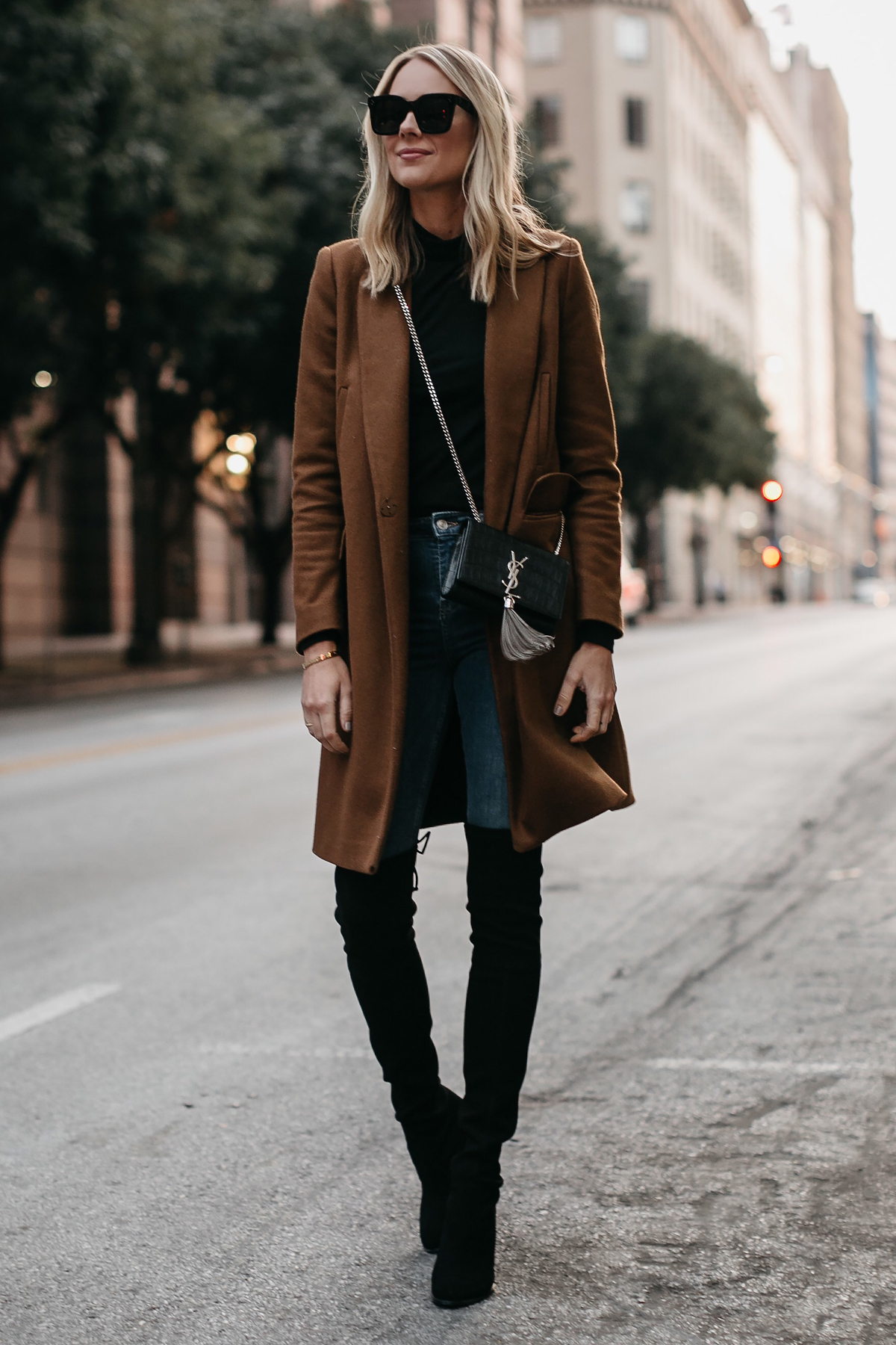 Blonde Woman Wearing Camel Wool Coat Denim Skinny Jeans Stuart Weitzman Black Over the Knee Boots Saint Laurent Crossbody Handbag Fashion Jackson Dallas Blogger Fashion Blogger Street Style