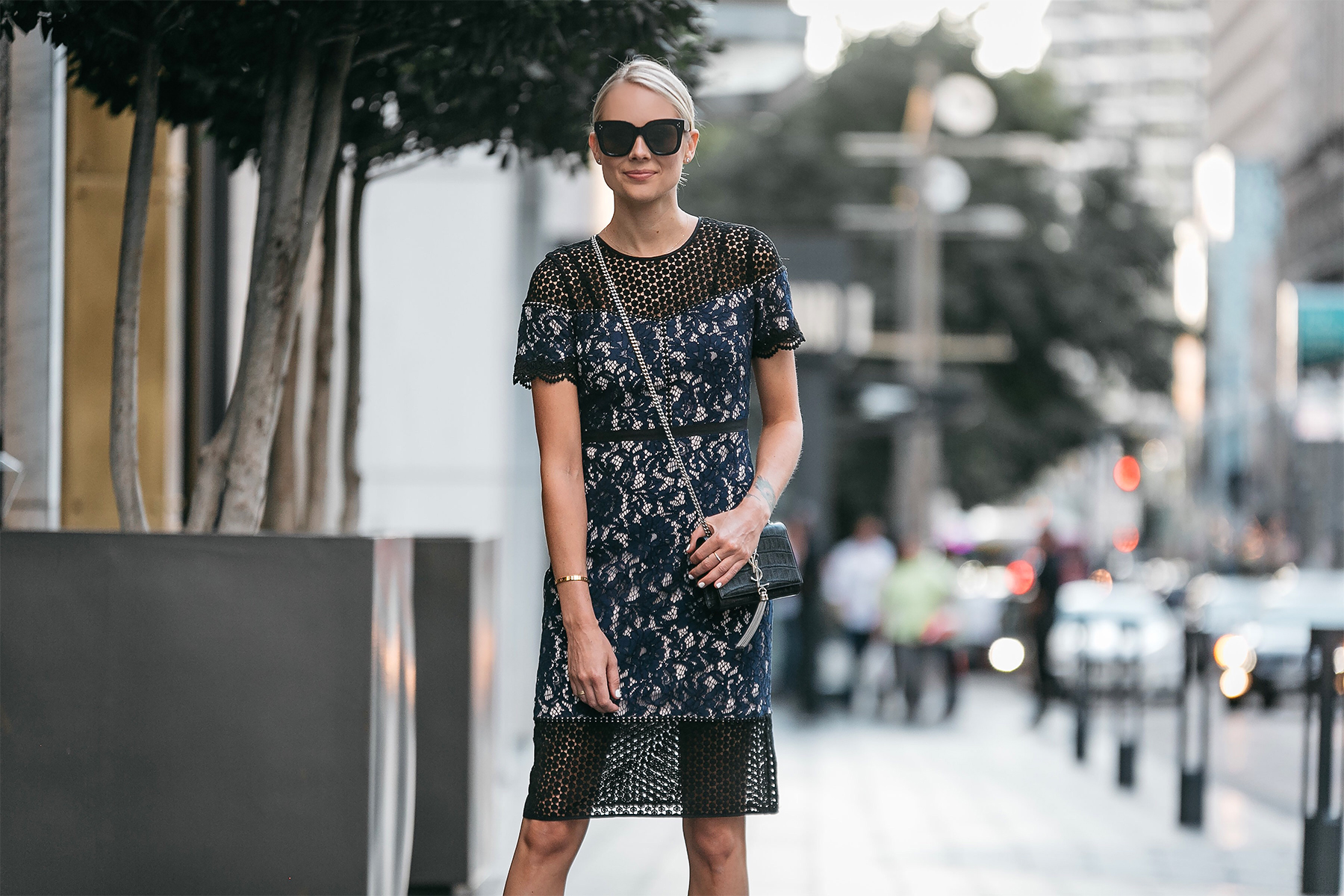 Blonde Woman Wearing Club Monaco Black Navy Lace Dress YSL Black Monogram Tassel Clutch Fashion Jackson Dallas Blogger Fashion Blogger Street Style