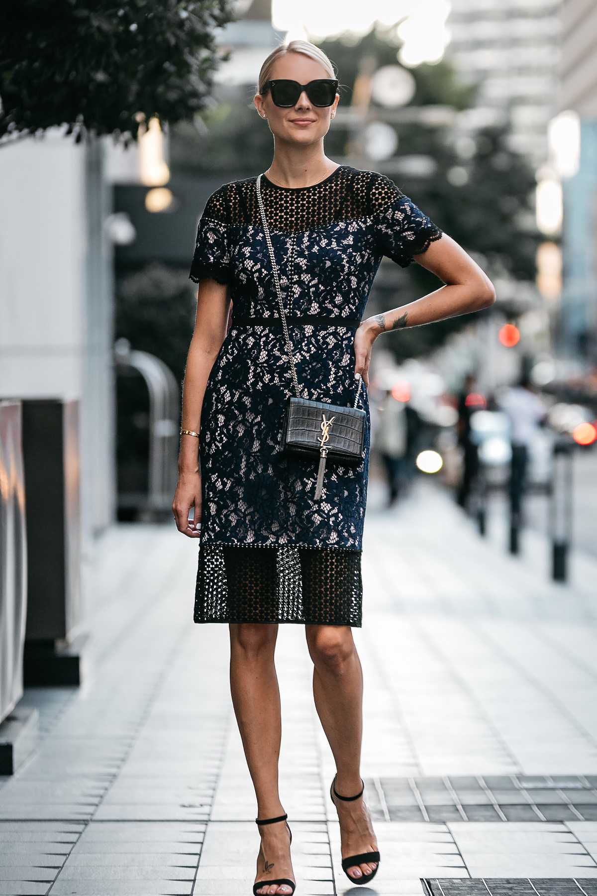 Blonde Woman Wearing Club Monaco Black Navy Lace Dress YSL Black Monogram Tassel Clutch Black Ankle Strap Heeled Sandals Fashion Jackson Dallas Blogger Fashion Blogger Street Style