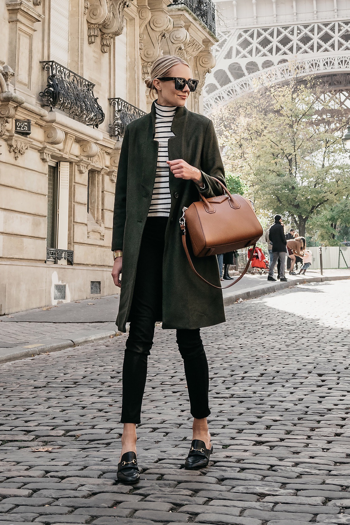Eiffel Tower Paris France Blonde Woman Wearing Green Wool Coat Black White Stripe Turtleneck Black Skinny Jeans Givency Antigona Cognac Satchel Gucci Mules Fashion Jackson Dallas Blogger Fashion Blogger Street Style