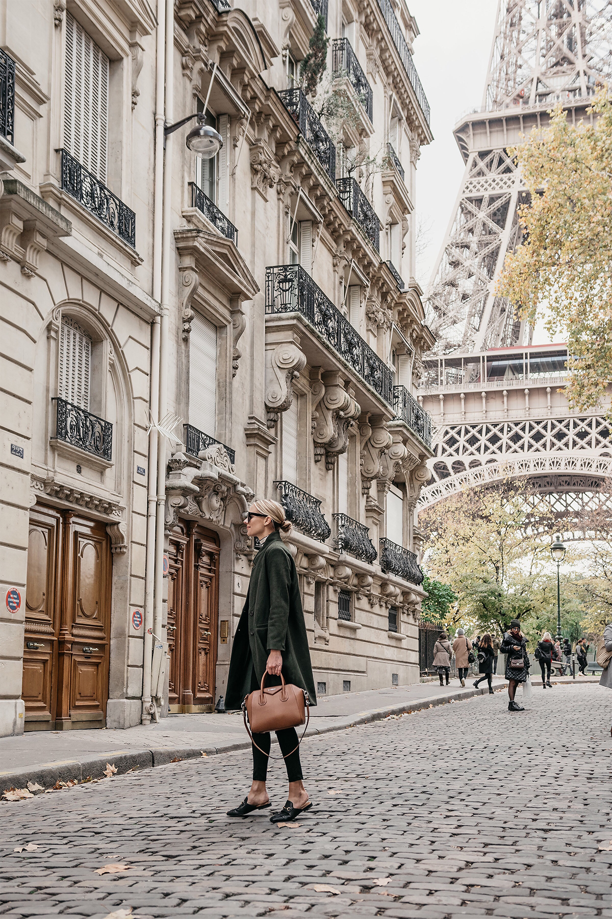 Eiffel Tower Paris France Blonde Woman Wearing Green Wool Coat Givency Antigona Cognac Satchel Gucci Mules Fashion Jackson Dallas Blogger Fashion Blogger Street Style