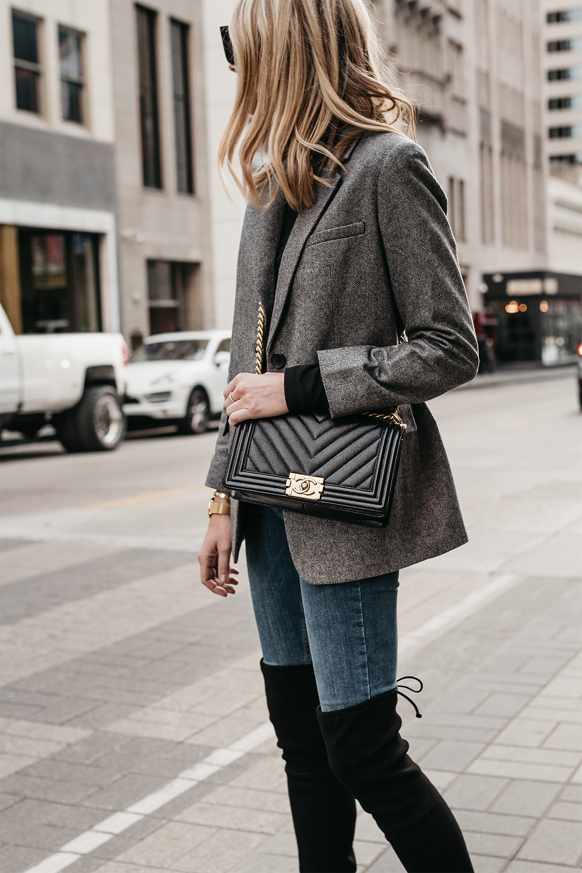 Blonde Woman Wearing Everlane Oversized Grey Blazer Chanel Black Boy Bag Denim Jeans Over the Knee Boots Fashion Jackson Dallas Blogger Fashion Blogger Street Style
