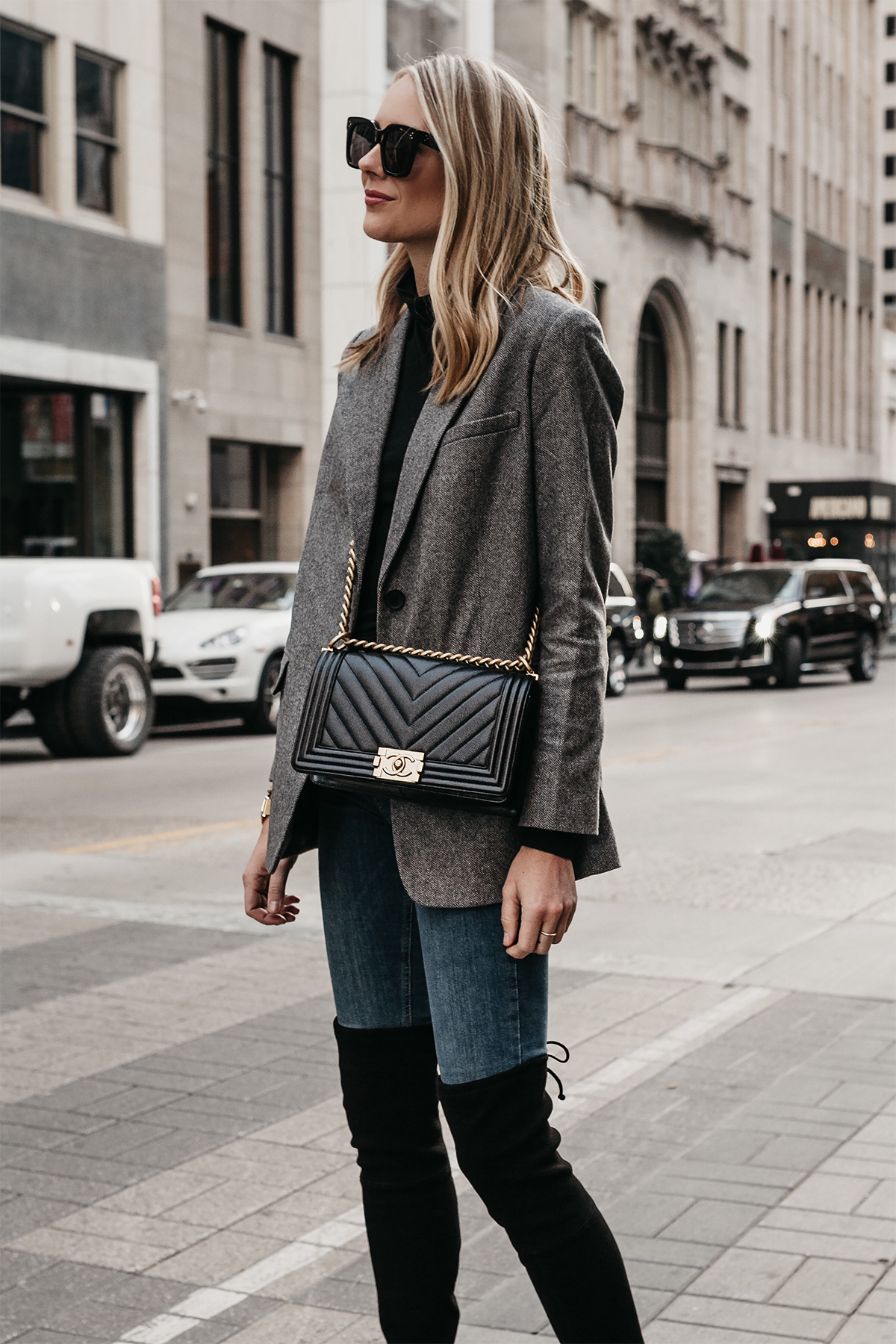 Blonde Woman Wearing Everlane Oversized Grey Blazer Denim Jeans Over the Knee Black Boots Chanel Black Boy Bag Fashion Jackson Dallas Blogger Fashion Blogger Street Style