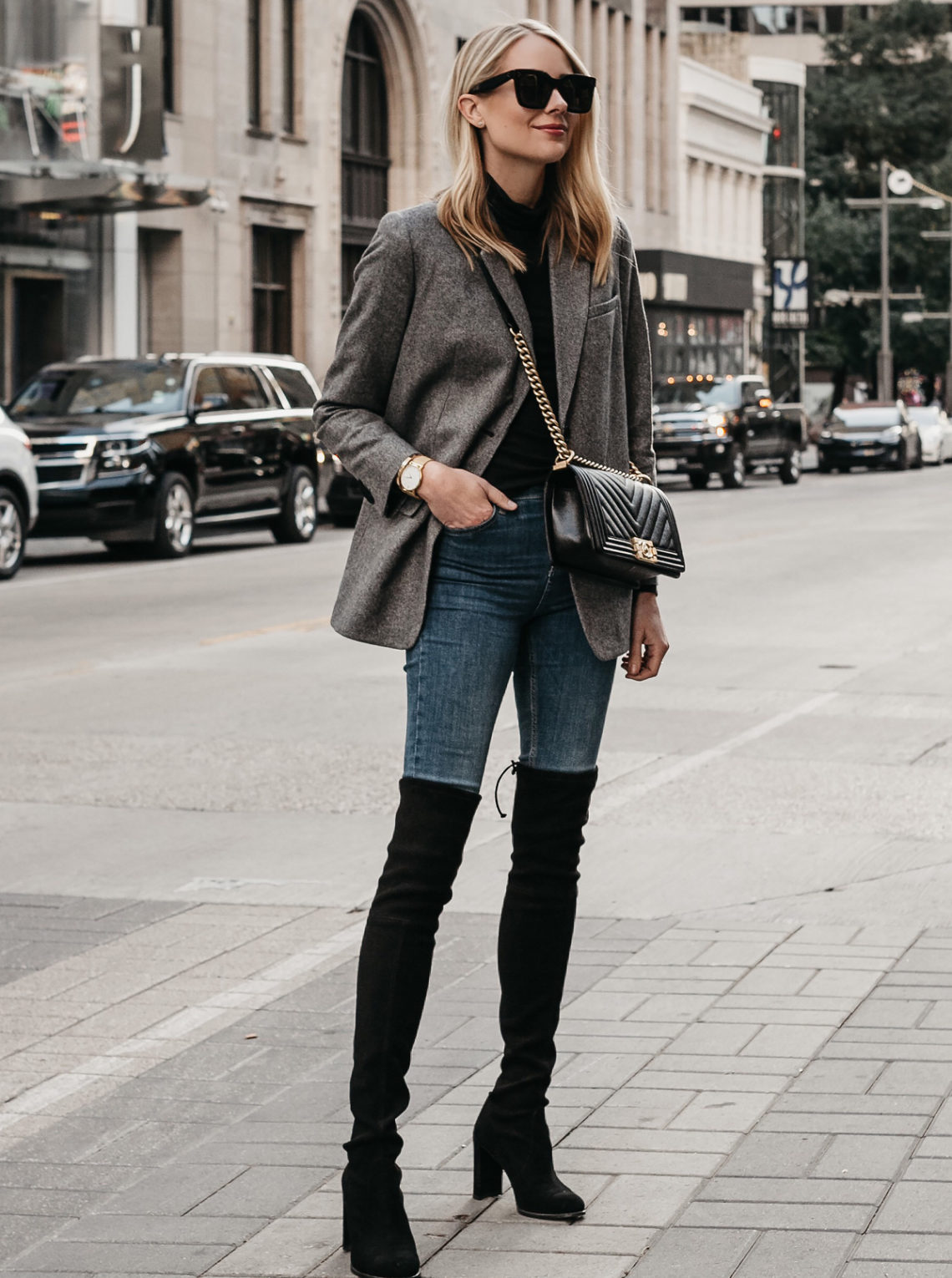 Blonde Woman Wearing Everlane Oversized Grey Blazer Denim Jeans Stuart Weitzman Over the Knee Black Boots Chanel Black Boy Bag Fashion Jackson Dallas Blogger Fashion Blogger Street Style