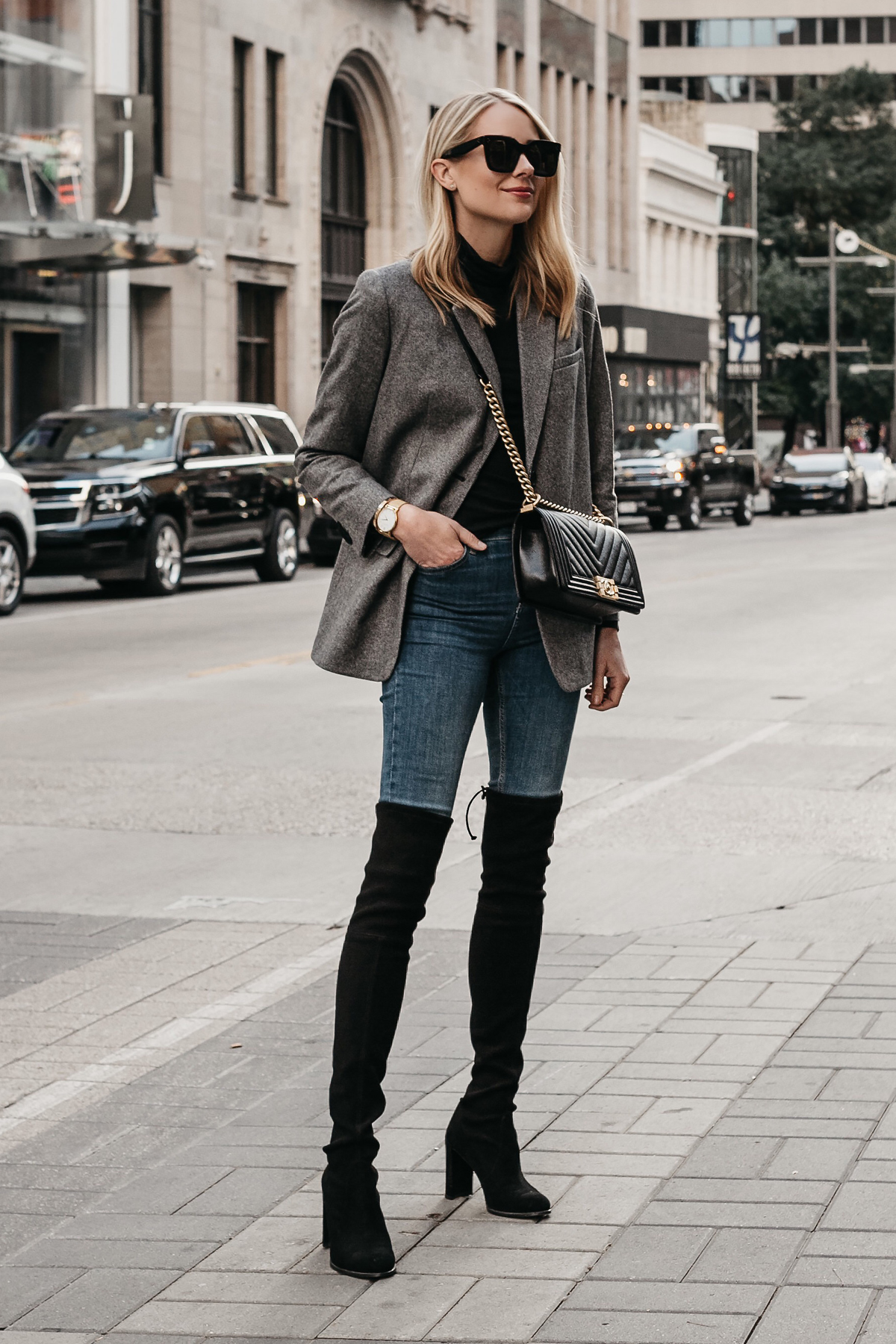 cde06b55090 Blonde Woman Wearing Everlane Oversized Grey Blazer Denim Jeans Stuart  Weitzman Over the Knee Black Boots .