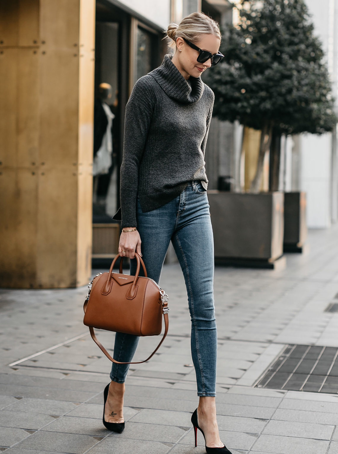 3b00c19a28e Blonde Woman Wearing Grey Turtleneck Sweater Denim Skinny Jeans Givenchy  Antigona Cognac Handbag Black Pumps Fashion