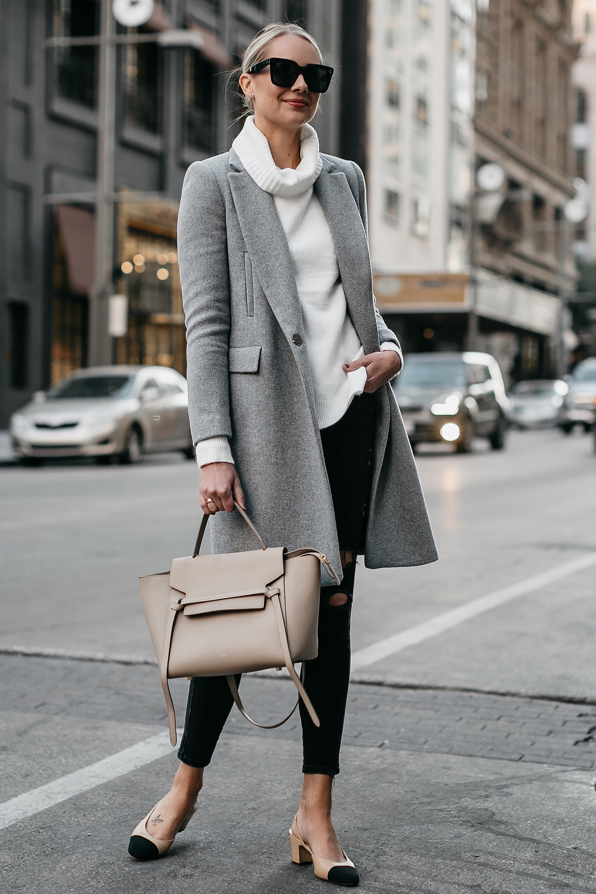 Blonde Woman Wearing Grey Wool Coat White Turtleneck Sweater Celine Mini Belt Bag Black Ripped Skinny Jeans Chanel Slingbacks Fashion Jackson Dallas Blogger Street Style
