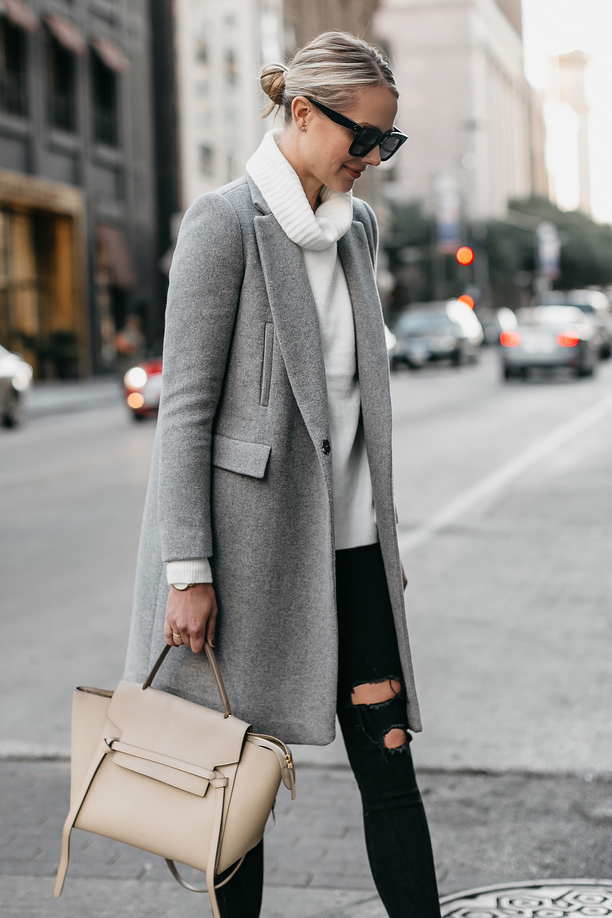 49e7f56d972 Blonde Woman Wearing Grey Wool Coat White Turtleneck Sweater Celine Mini  Belt Bag Black Ripped Skinny