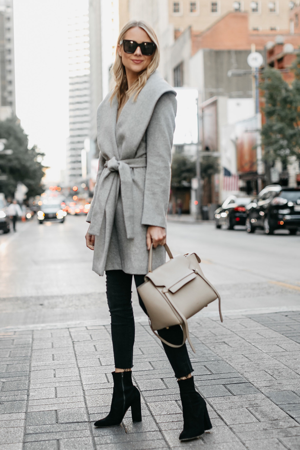 Blonde Woman Wearing Grey Wrap Coat Black Skinny Jeans Black Booties Outfit Celine Mini Belt Bag Fashion Jackson Dallas Blogger Fashion Blogger Street Style