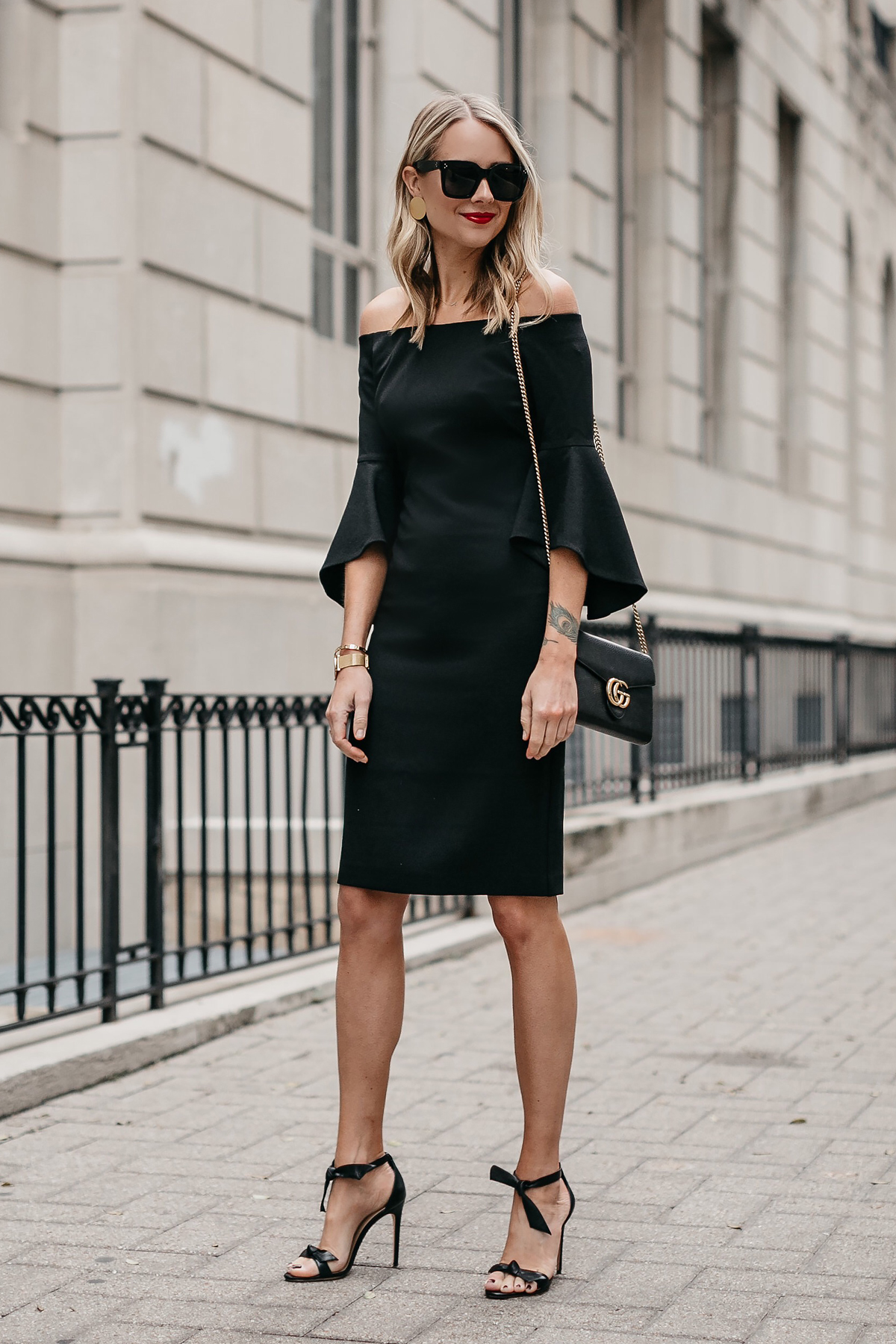 Blonde Woman Wearing Off-the-Shoulder Black Holiday Dress Alexandre Birman Clarita Ankle Tie Black Heels Gucci Marmont Handbag Fashion Jackson Dallas Blogger Fashion Blogger Street Style