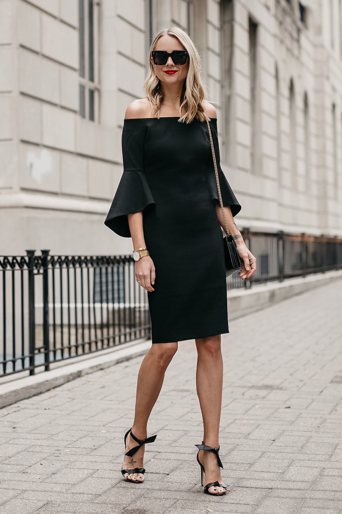 Blonde Woman Wearing Off-the-Shoulder Black Holiday Dress Alexandre Birman Clarita Ankle Tie Black Heels Fashion Jackson Dallas Blogger Fashion Blogger Street Style