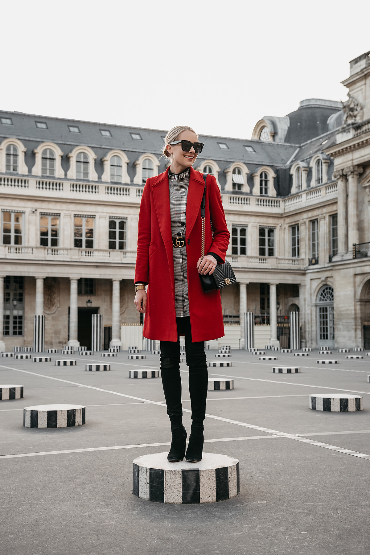 Blonde Woman Wearing Red Wool Coat Plaid Dress Black Jeans Black Booties Gucci Marmont Belt Chanel Black Gold Boy Bag Paris Palais Royal Fashion Jackson Dallas Blogger Fashion Blogger Street Style