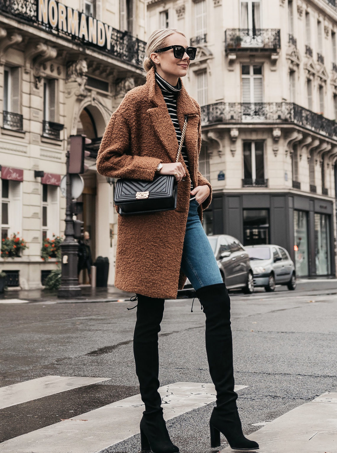 Blonde Woman Wearing Teddy Bear Coat Black White Stripe Turtleneck Sweater Denim Jeans Stuart Weitzman Black Over-the-Knee Boots Chanel Boy Bag Paris Street Style Fashion Jackson Dallas Blogger Fashion Blogger Street Style