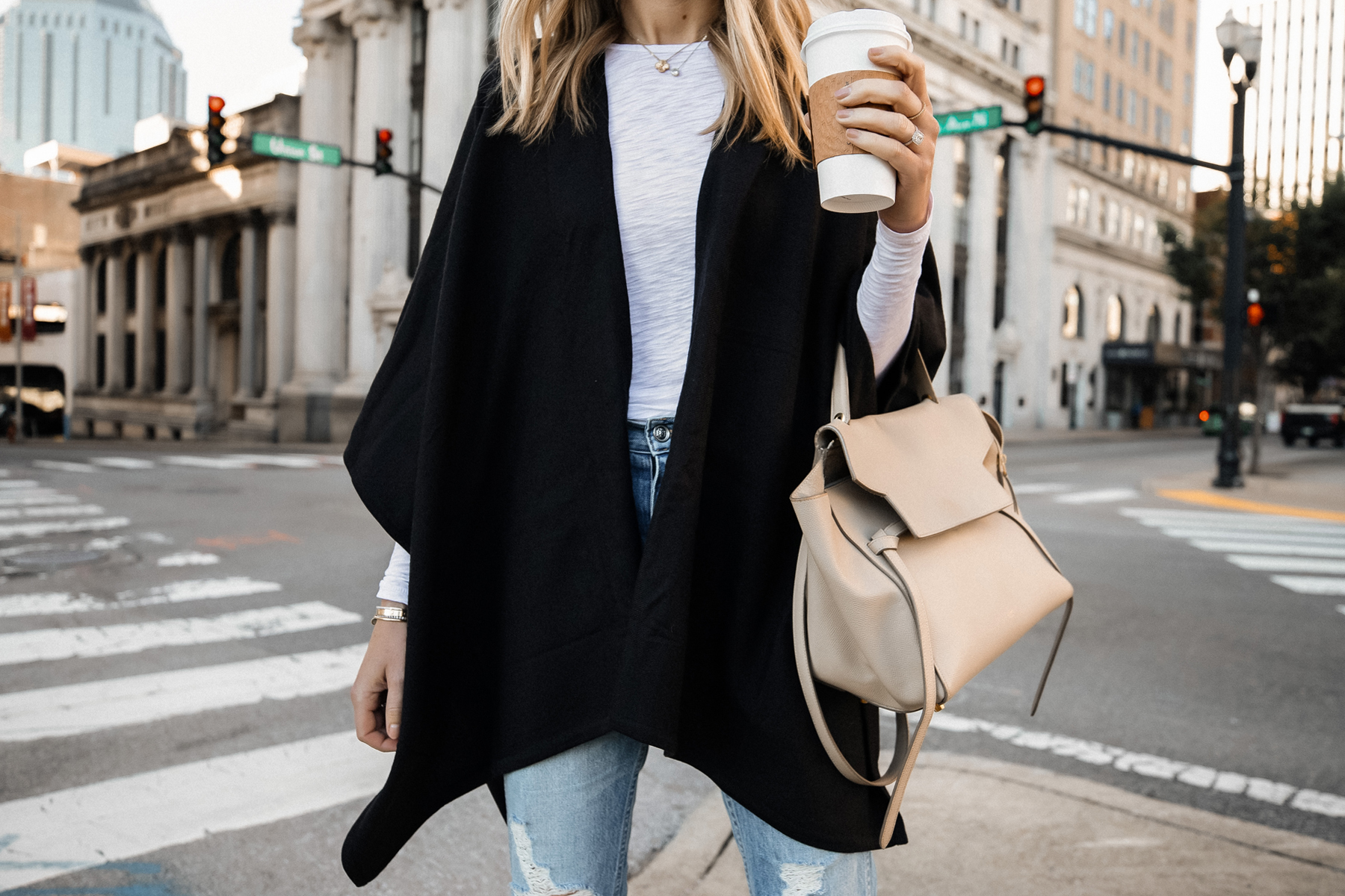 Fashion Jackson Wearing Black Poncho White Long Sleeve Top Ripped Jeans Celine Mini Belt Bag