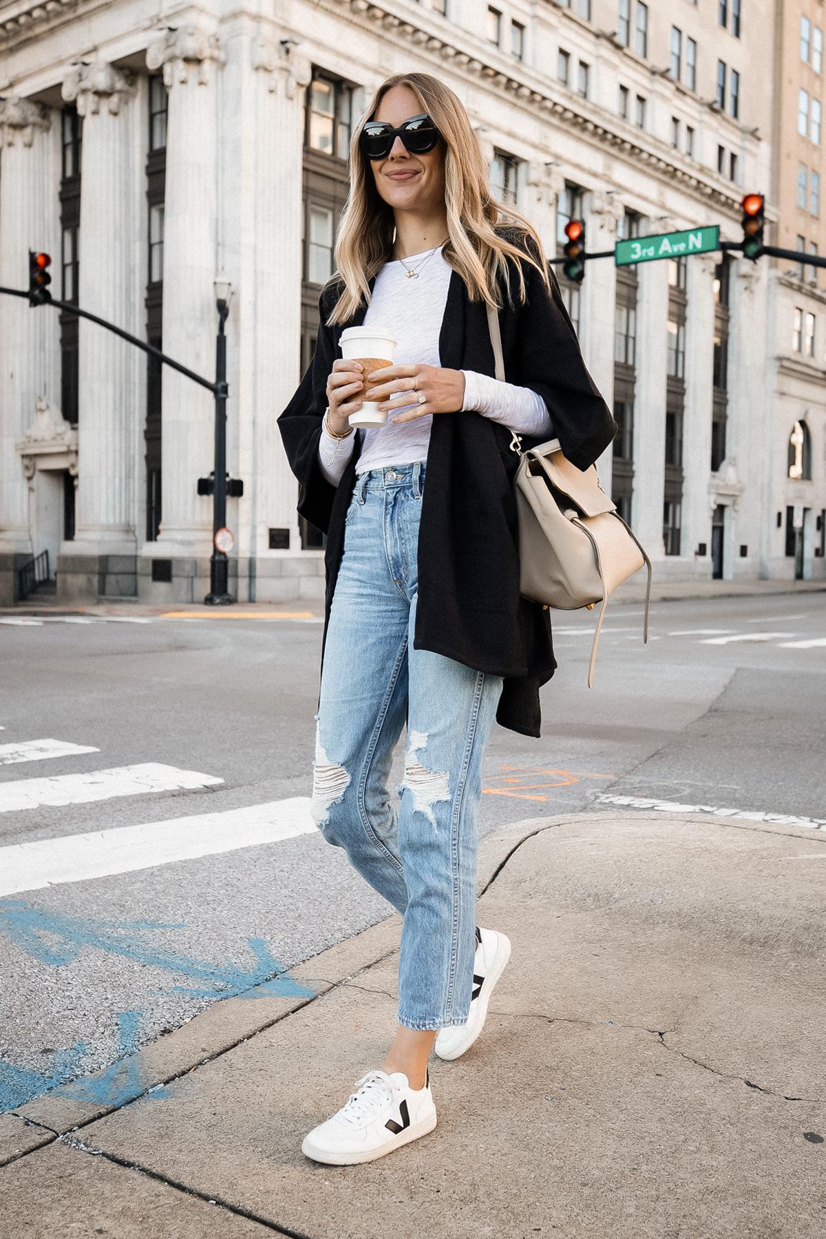 Fashion Jackson Wearing Black Poncho White Long Sleeve Top Ripped Jeans Veja V10 Sneakers Celine Mini Belt Bag 3