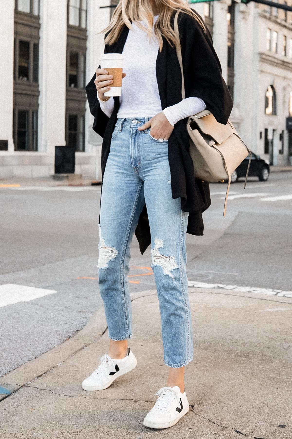 Fashion Jackson Wearing Black Poncho White Long Sleeve Top Ripped Jeans Veja V10 Sneakers Celine Mini Belt Bag 2