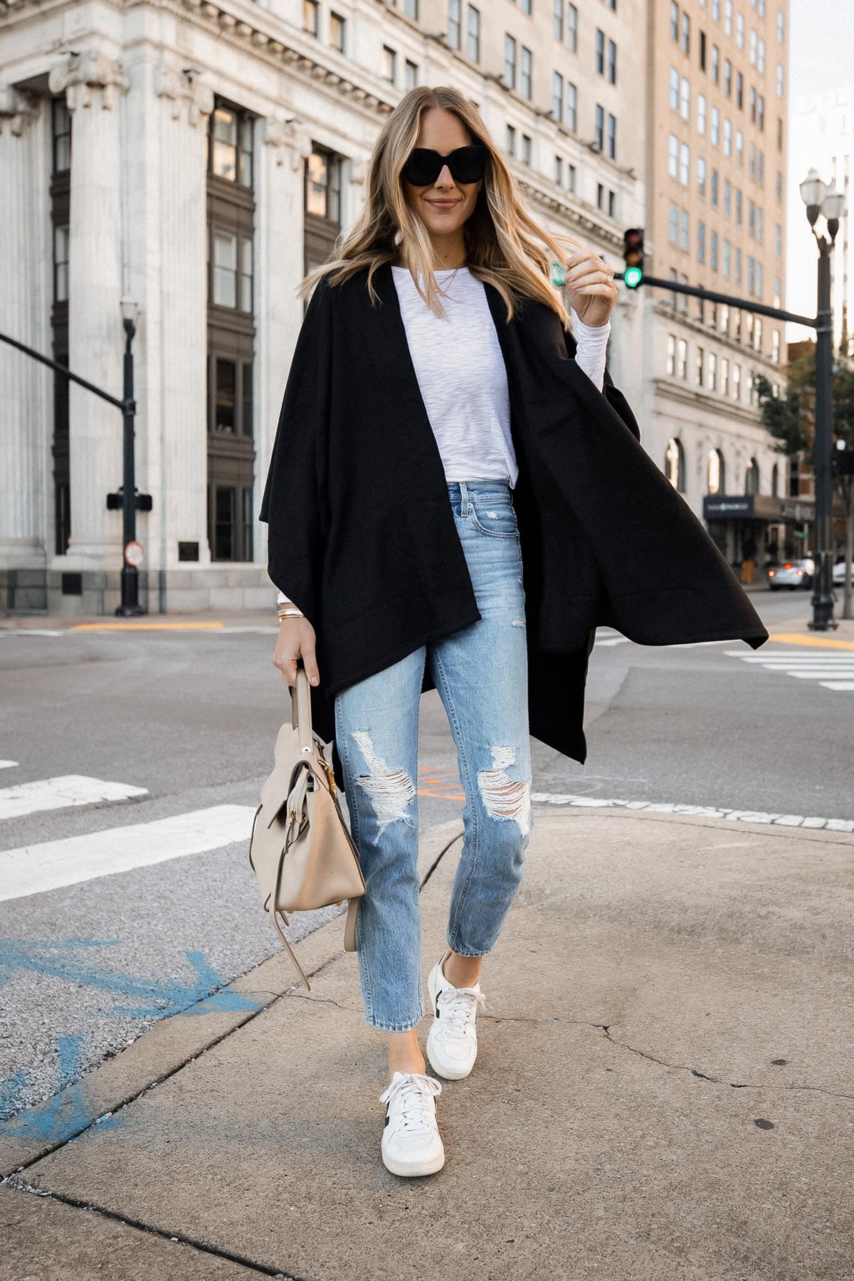 Fashion Jackson Wearing Black Poncho White Long Sleeve Top Ripped Jeans Veja V10 Sneakers Celine Mini Belt Bag