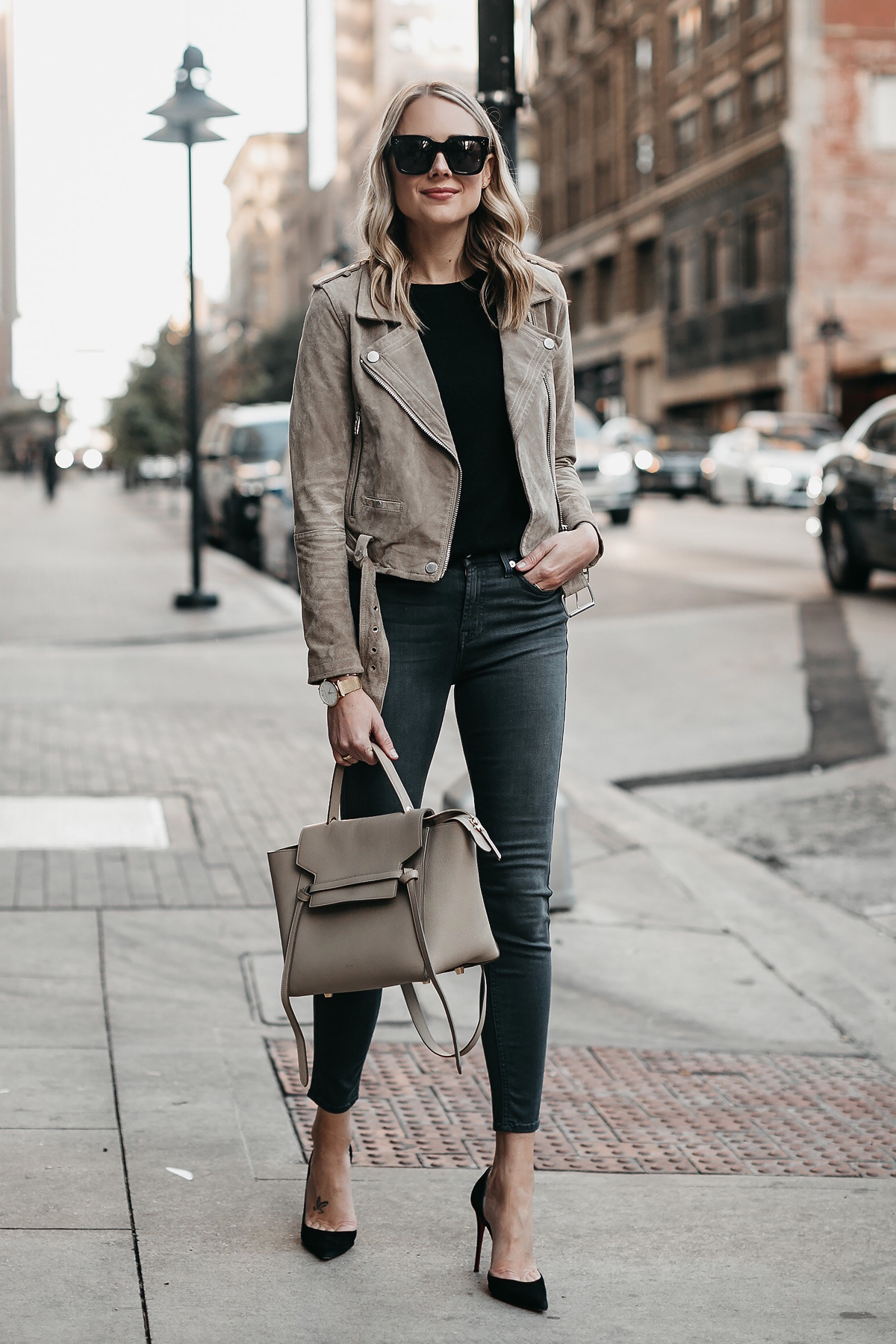 953bef05f9 Blonde Woman Wearing Blanknyc Suede Moto Jacket Black Sweater 7 For All  Mankind Grey Skinny Jeans