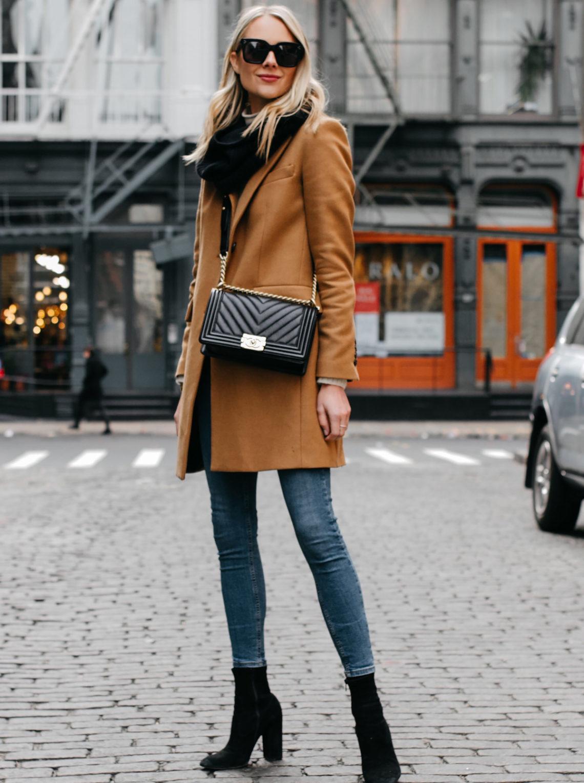 Blonde Woman Wearing Camel Coat Black Scarf Denim Skinny Jeans Black Booties Chanel Black Boy Bag Fashion Jackson Dallas Blogger Fashion Blogger NYC Street Style