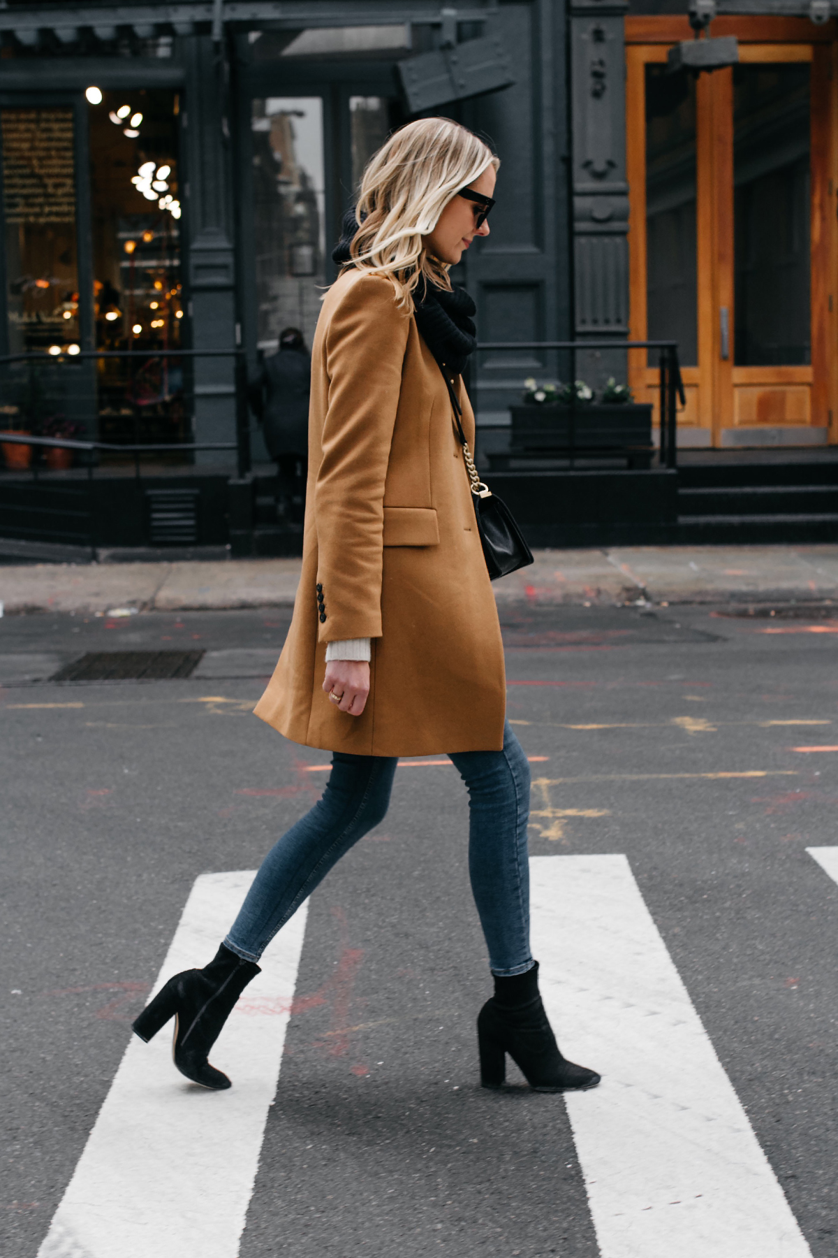 Blonde Woman Wearing Camel Coat Black Scarf Denim Skinny Jeans Black Booties Fashion Jackson Dallas Blogger Fashion Blogger NYC Street Style