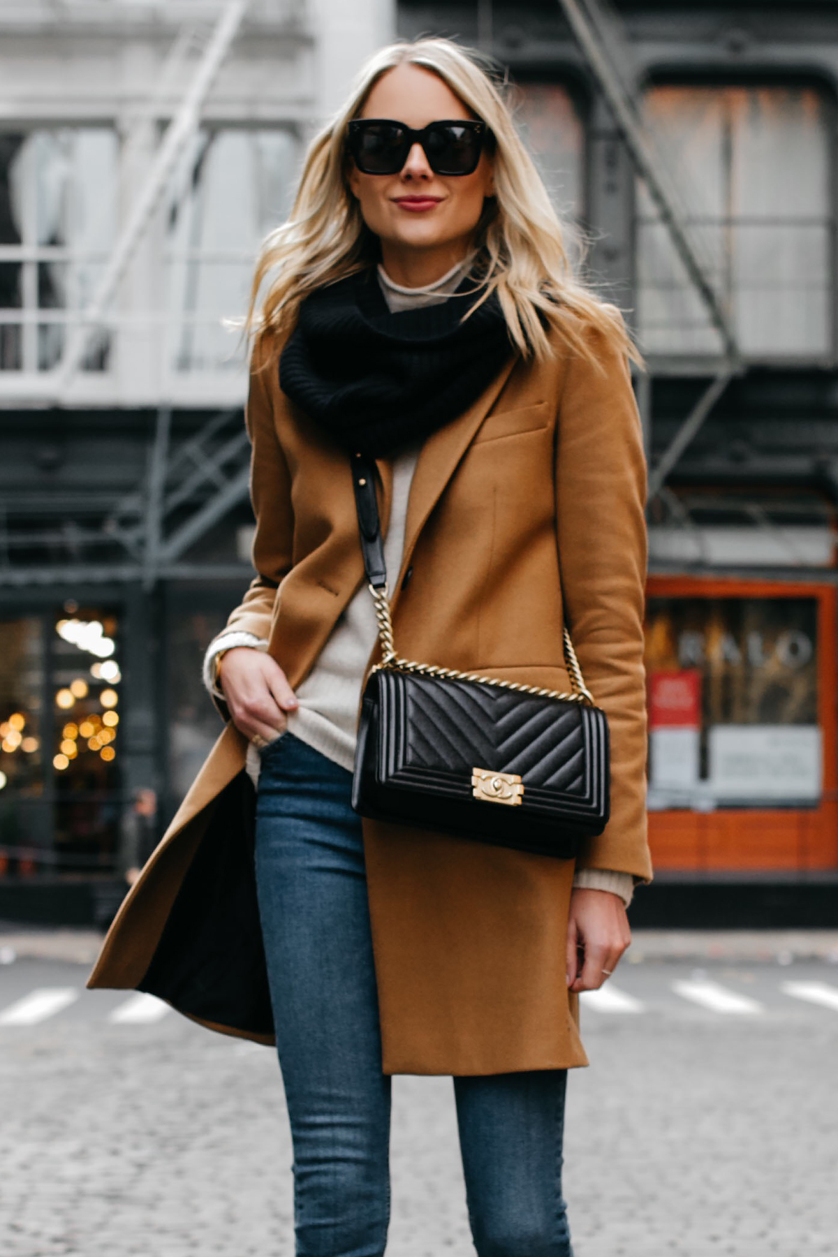 Blonde Woman Wearing Camel Coat Black Scarf Denim Skinny Jeans Chanel Black Boy Bag Fashion Jackson Dallas Blogger Fashion Blogger NYC Street Style