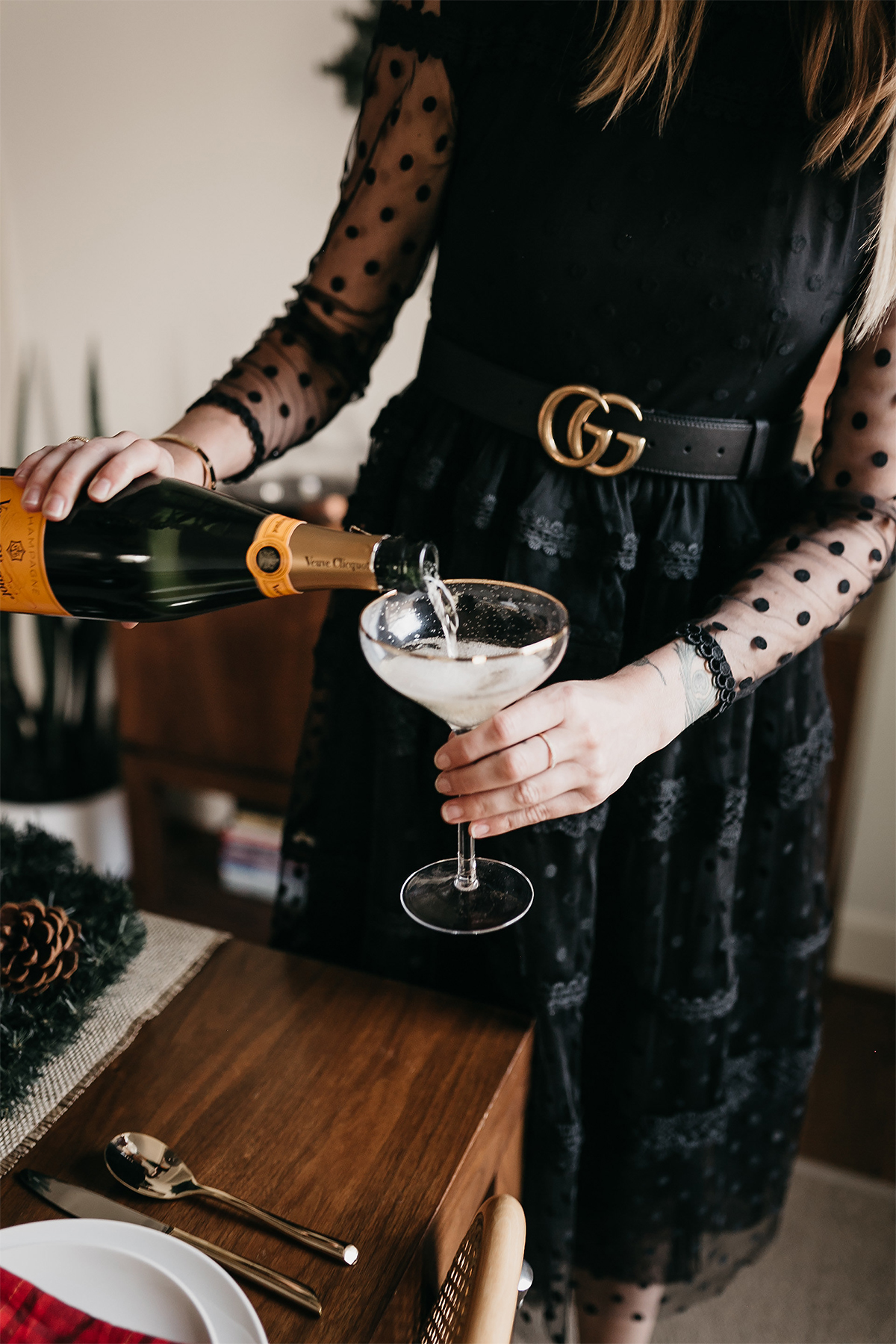 Fashion Jackson Christmas Holiday Tablescape Veuve Clicquot Champagne Black Lace Dress Gucci Belt
