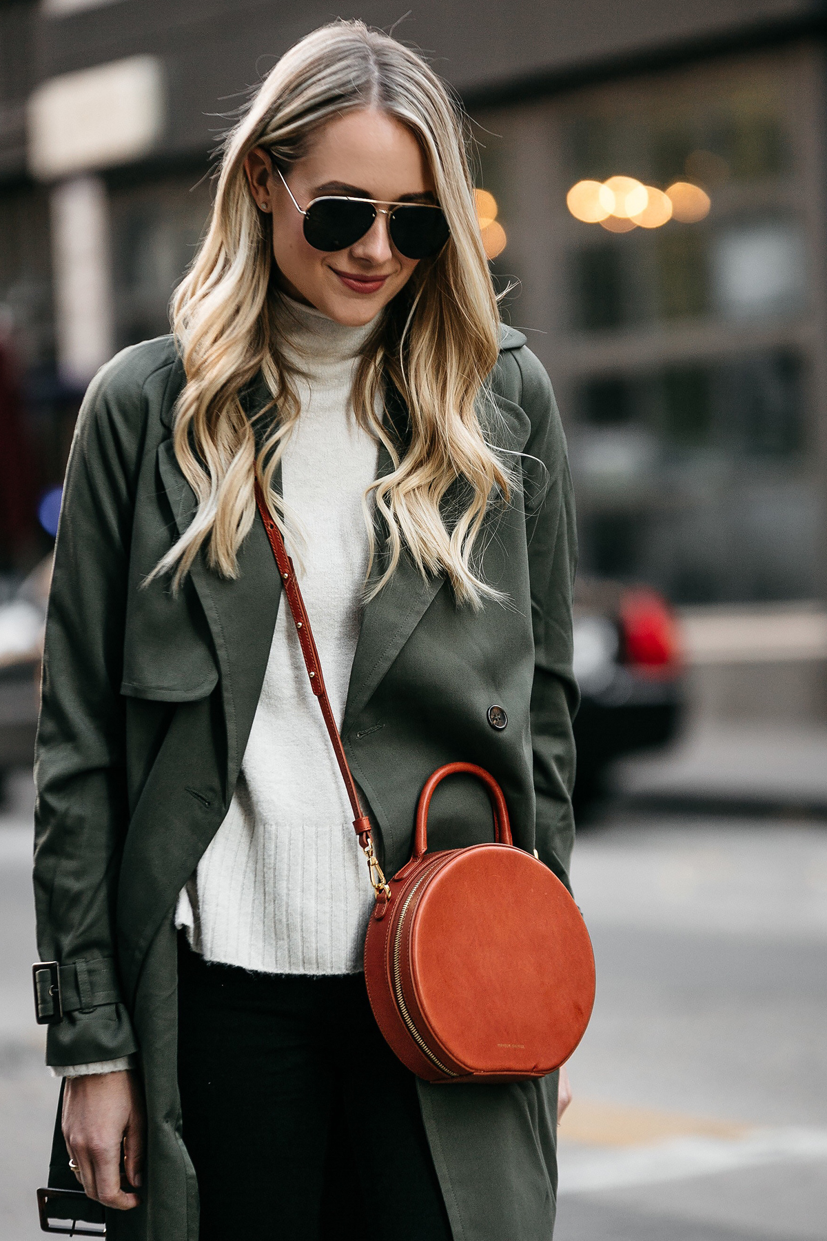 Blonde Woman Wearing Green Trench Coat White Sweater Mansur Gavriel Circle Crossbody Fashion Jackson Dallas Blogger Fashion Blogger Street Style