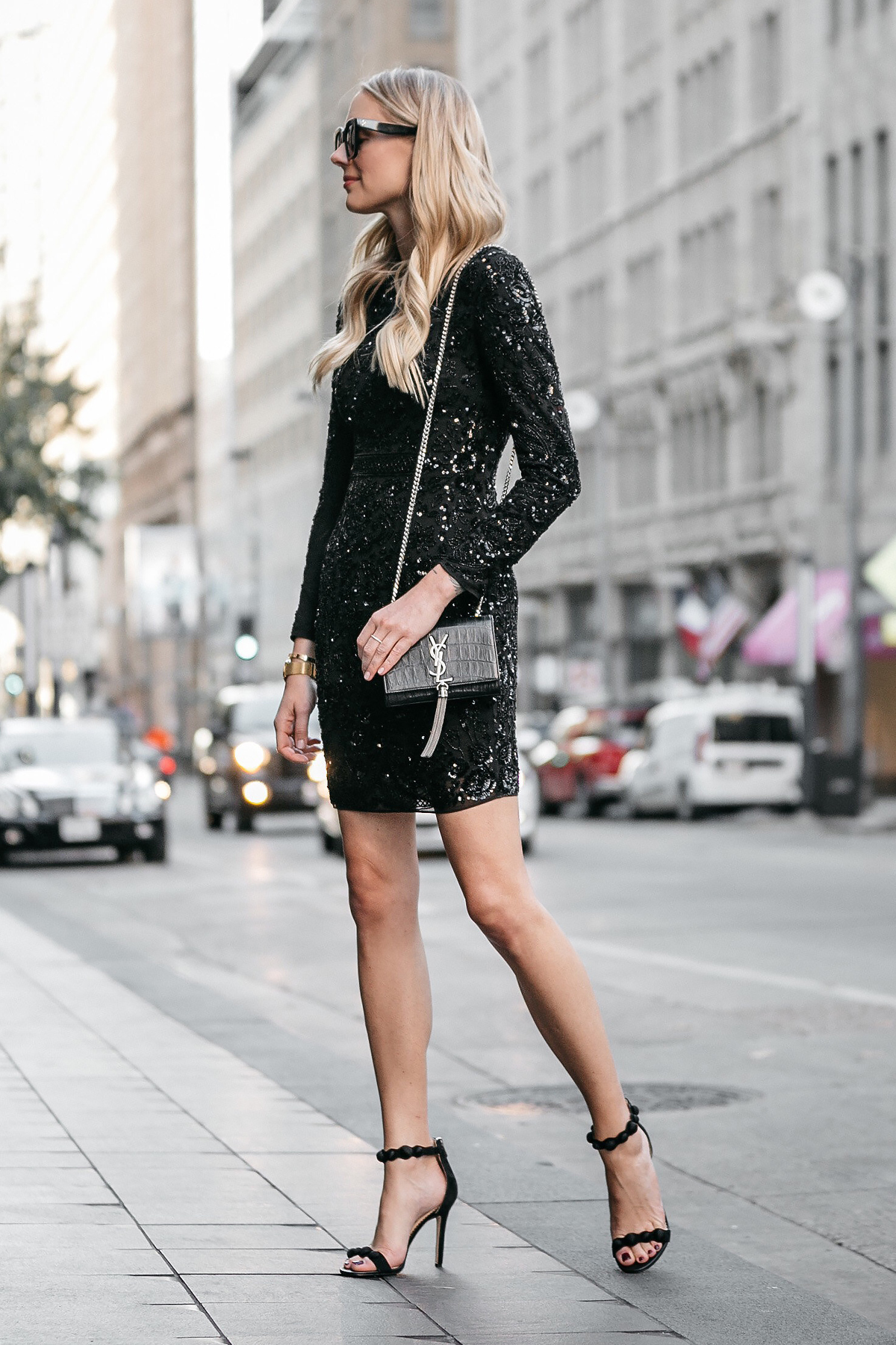Blonde Woman Wearing Long Sleeve Black Sequin Dress Needle and Thread Black Ankle Strap Heels YSL Black Crocodile Crossbody Fashion Jackson Dallas Blogger Fashion Blogger Street Style NYE Outfit
