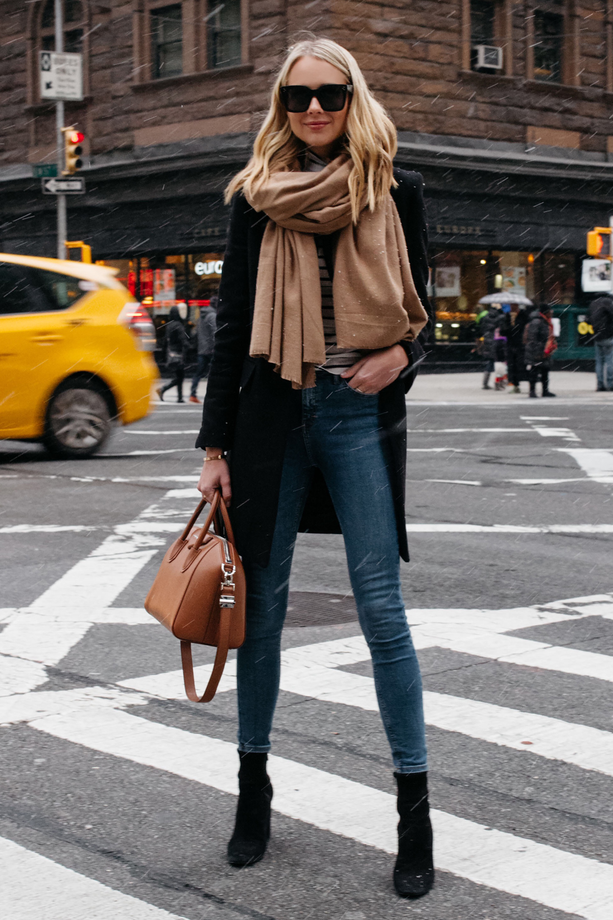 Blonde Woman Wearing Tan Scarf Black Wool Coat Striped Top Denim Skinny Jeans Black Booties Givenchy Antigona Satchel Fashion Jackson Dallas Blogger Fashion Blogger Street Style NYC