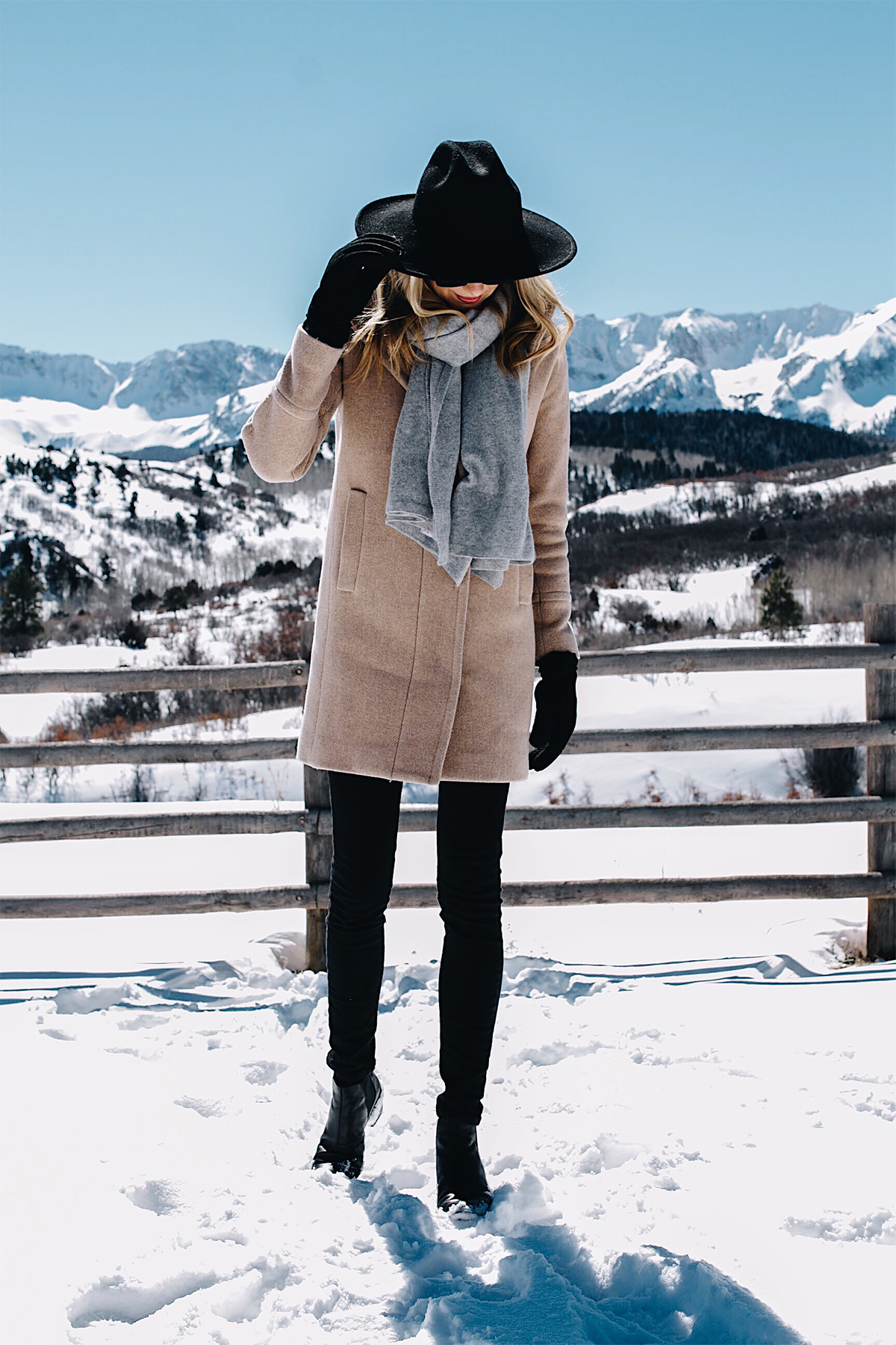 Telluride CO Snow Mountains Blonde Woman Wearing Grey Scarf Camel Coat Black Skinny Jeans Black Wool Hat Black Gloves Fashion Jackson Dallas Blogger Fashion Blogger Street Style