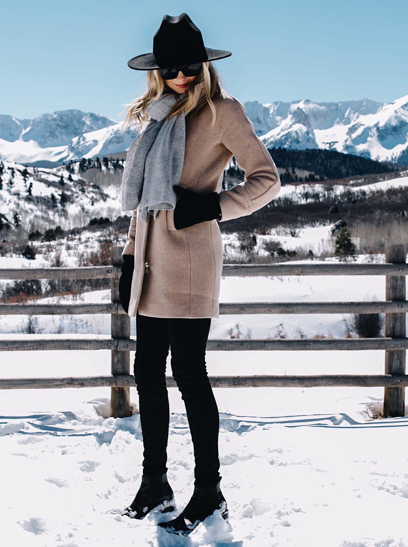 Telluride CO Snow Mountains Blonde Woman Wearing Grey Scarf Camel Coat Black Skinny Jeans Black Wool Hat Black Gloves Fashion Jackson Dallas Blogger Fashion Blogger