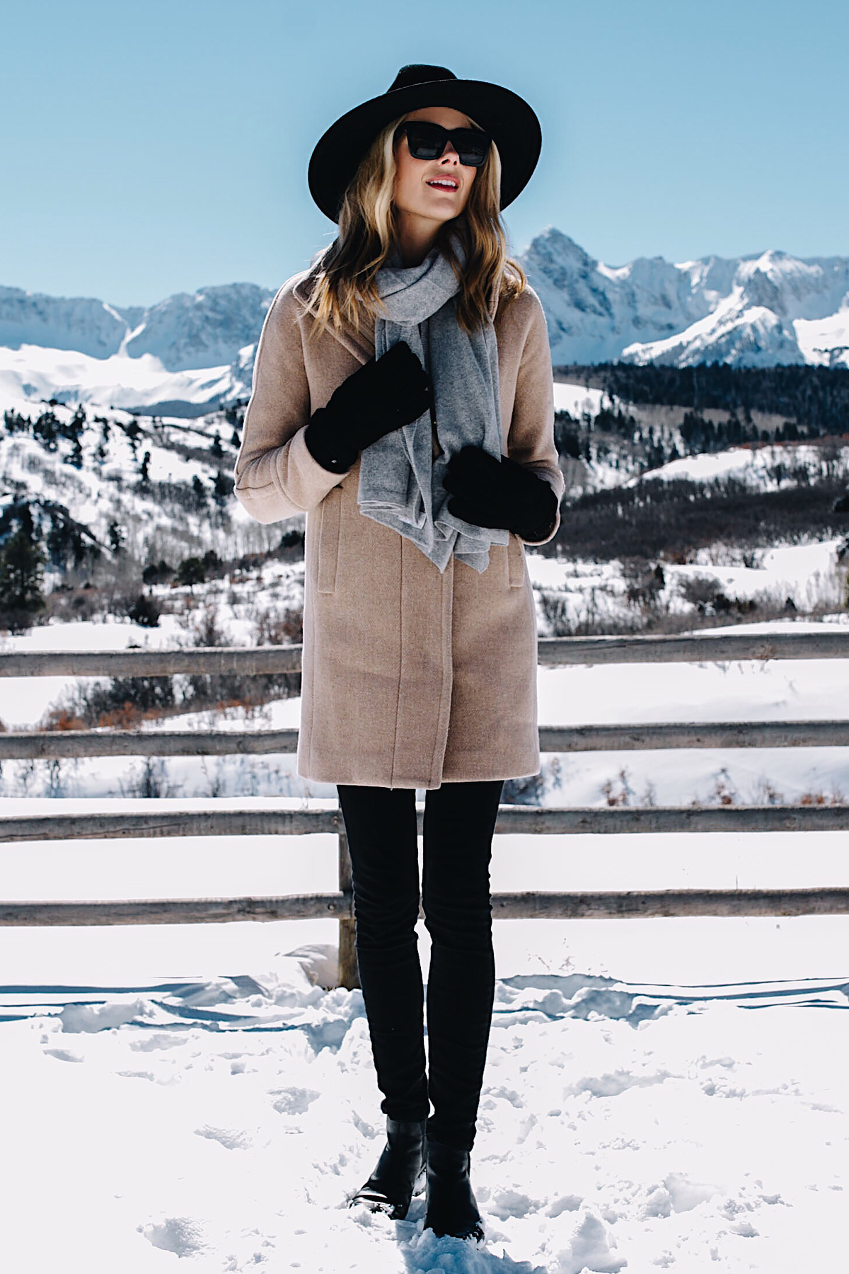 Telluride CO Snow Mountains Blonde Woman Wearing Grey Scarf Camel Coat Black Skinny Jeans Black Wool Hat Black Gloves Fashion Jackson Dallas Blogger Fashion Blogger