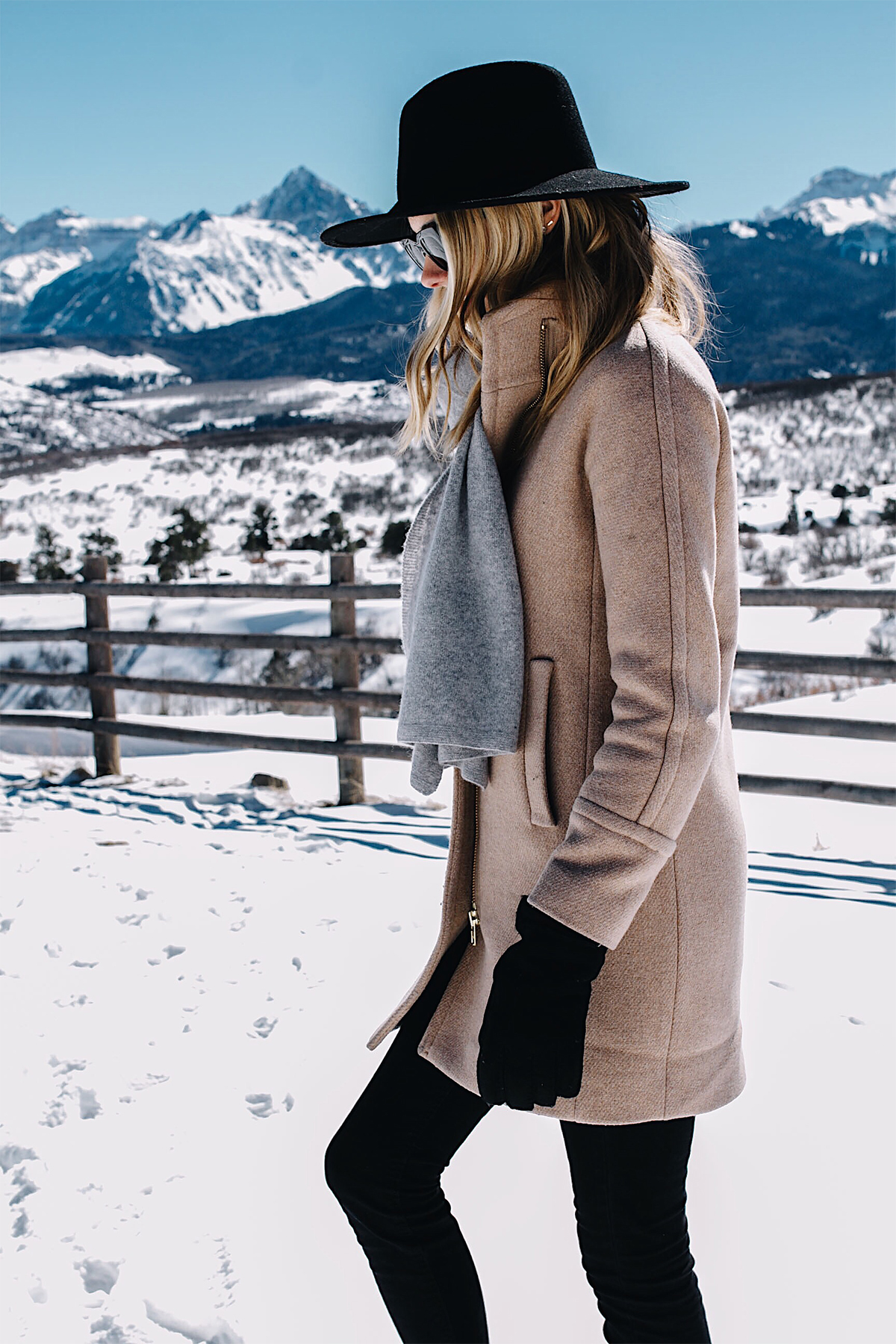 Telluride CO Snow Mountains Blonde Woman Wearing Grey Scarf Camel Coat Black Wool Hat Black Gloves Fashion Jackson Dallas Blogger Fashion Blogger
