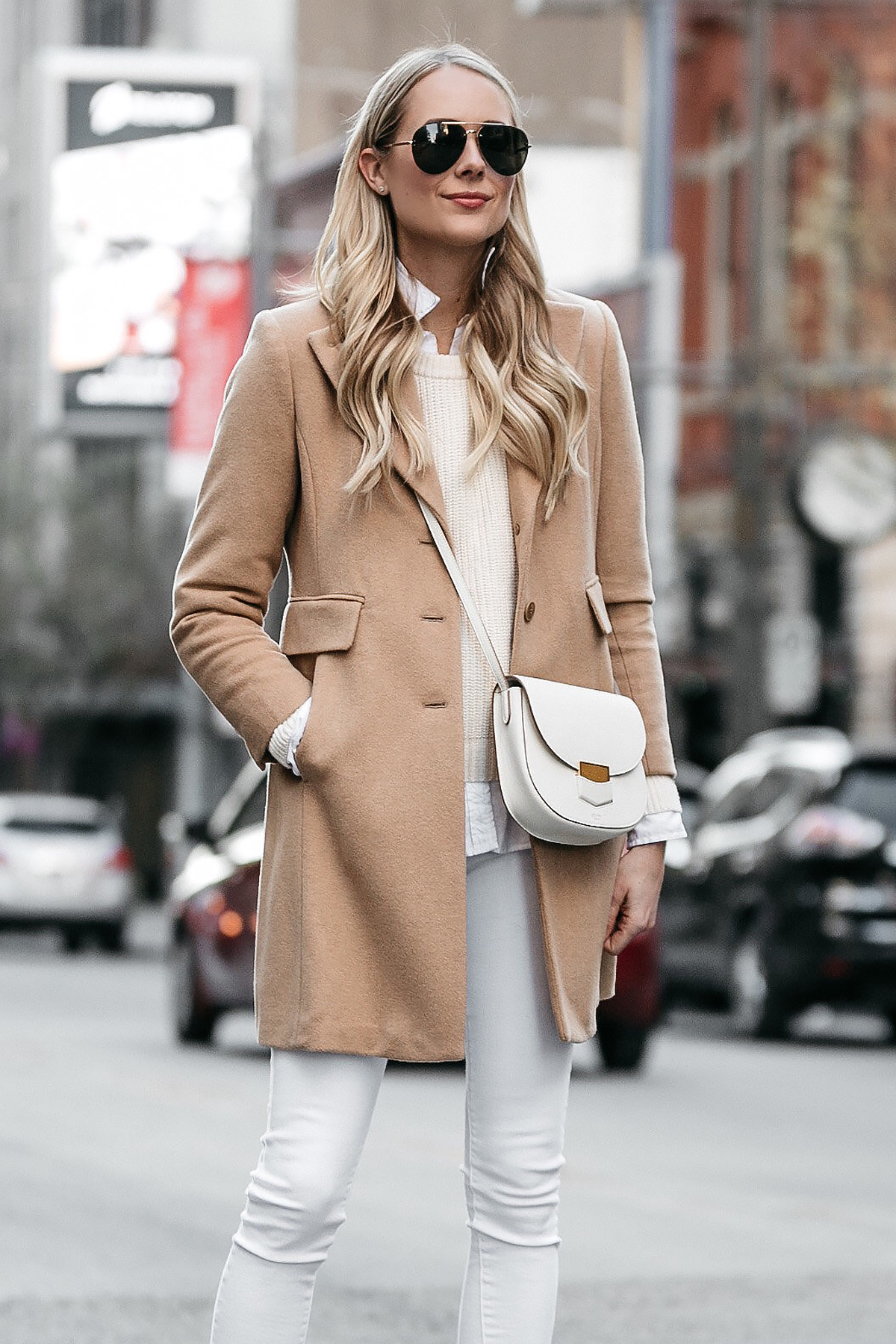 Blonde Woman Wearing Camel Wool Coat White Skinny Jeans Celine Trotteur White Handbag Fashion Jackson Dallas Blogger Fashion Blogger Street Style