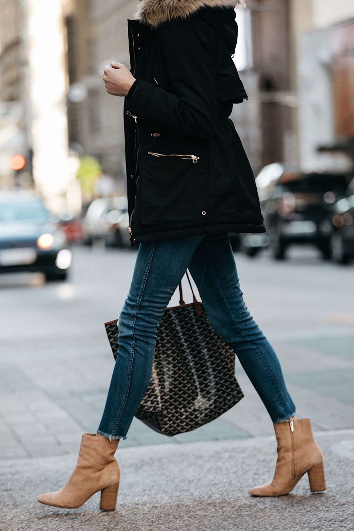 Woman Wearing Black Parka Denim Skinny Jeans Tan Booties Goyard Tote Fashion Jackson Dallas Blogger Fashion Blogger Street Style