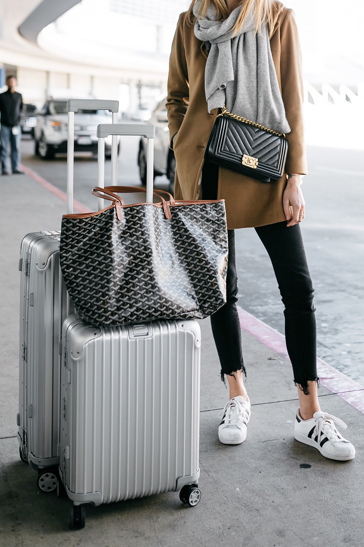 Woman Wearing Camel Coat Black Ripped Skinny Jeans Grey Scarf Chanel Black Boy Bag adidas Superstar Sneakers Rimowa Luggage Goyard Tote Fashion Jackson Dallas Blogger Fashion Blogger Street Style Airport Style