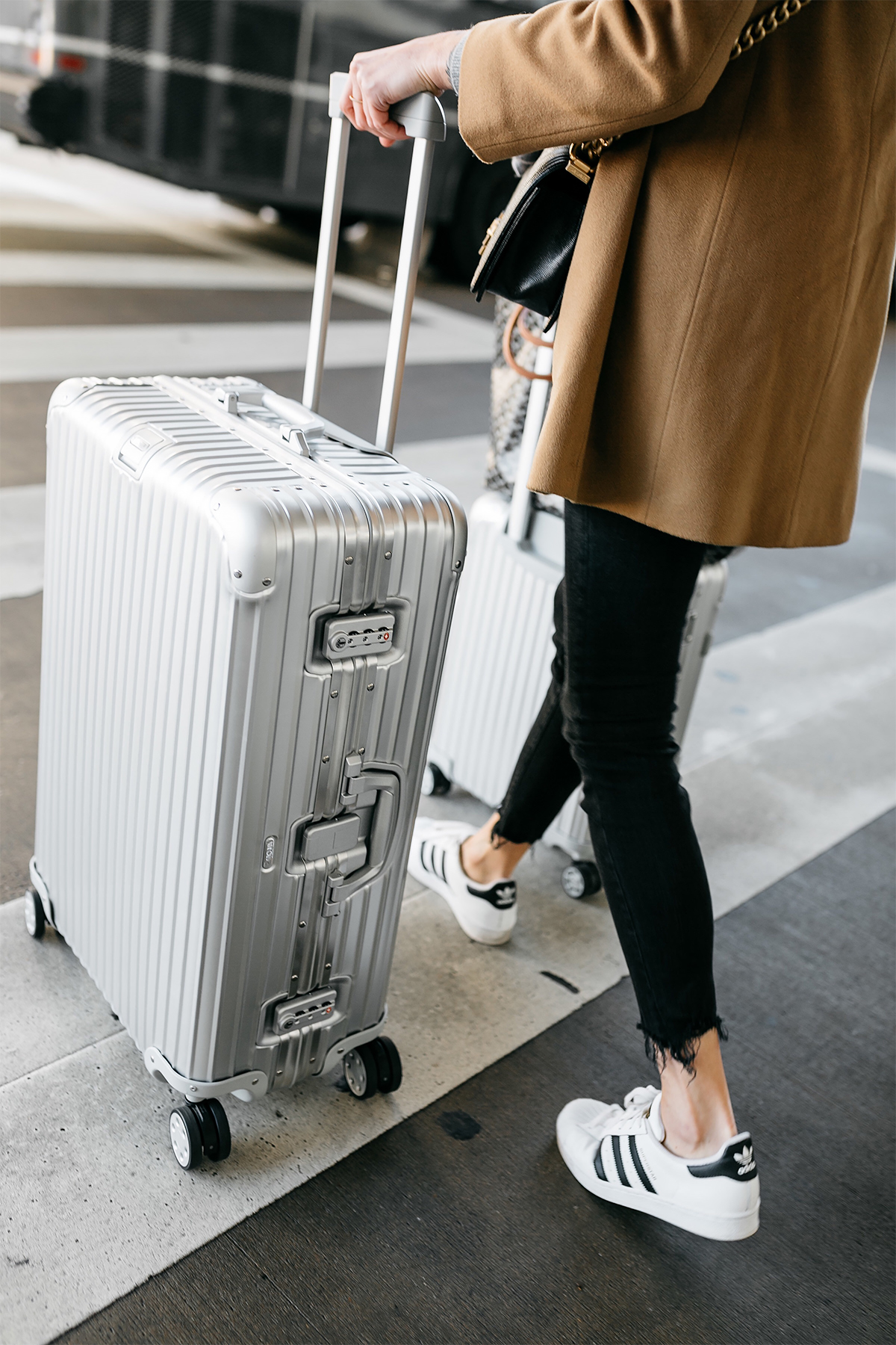 Woman Wearing Camel Coat Black Ripped Skinny Jeans adidas Superstar Sneakers Rimowa Luggage Fashion Jackson Dallas Blogger Fashion Blogger Street Style Airport Style