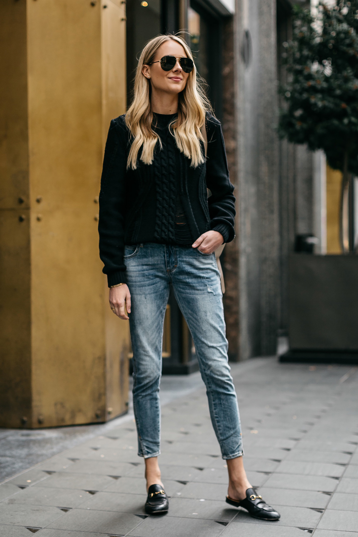 Blonde Woman Wearing Black Sweater Denim Jeans Outfit Frame Black Cable Knit Sweater Denim Split Hem Skinny Jeans Gucci Loafer Mules Celine Aviator Sunglasses Fashion Jackson Dallas Blogger Fashion Blogger Street Style