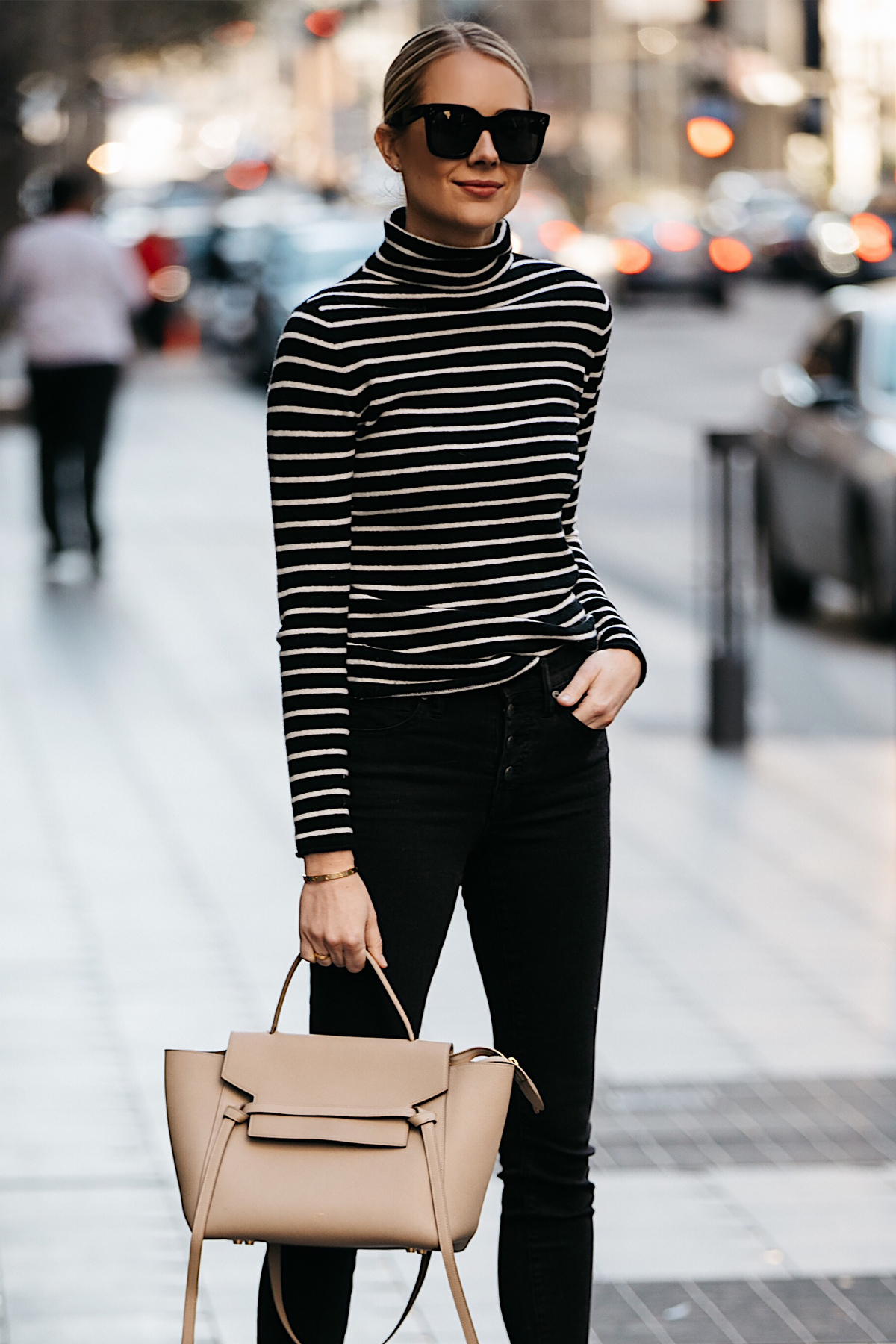 Blonde Woman Wearing Nordstrom Black White Striped Turtleneck Sweater Black Skinny Jeans Outfit Celine Mini Belt Bag Fashion Jackson Dallas Blogger Fashion Blogger Street Style