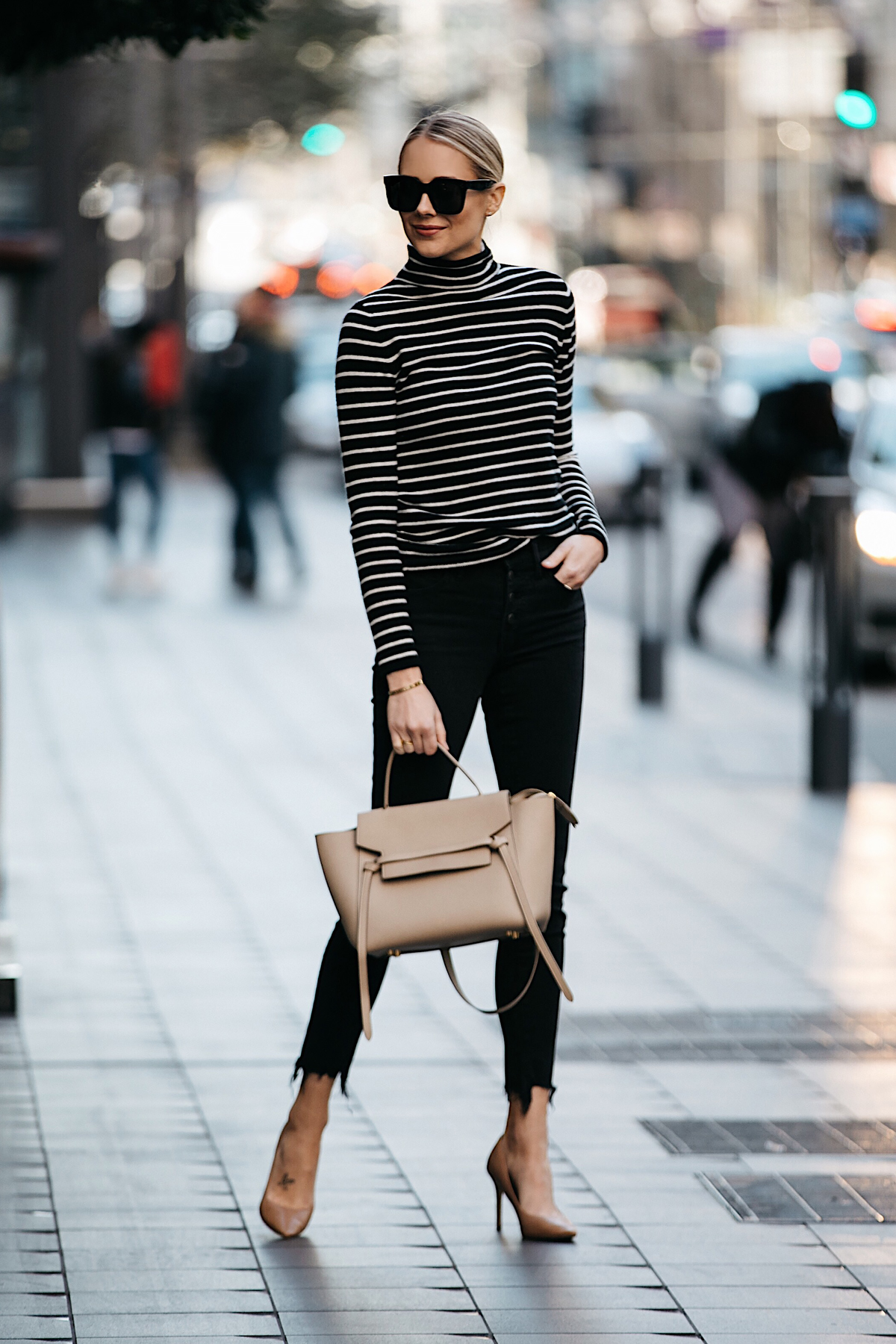 8b9b09f4ee Blonde Woman Wearing Nordstrom Black White Striped Turtleneck Sweater Black  Skinny Jeans Nude Pumps Outfit Celine