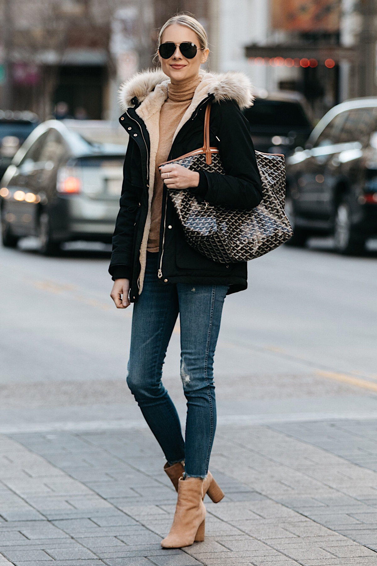 Blonde Woman Wearing Zara Faux Fur Trimmed Black Parka Jacket Denim Jeans Tan Turtleneck Sam Edelman Corra Booties Goyard Tote Fashion Jackson Dallas Blogger Fashion Blogger Street Style