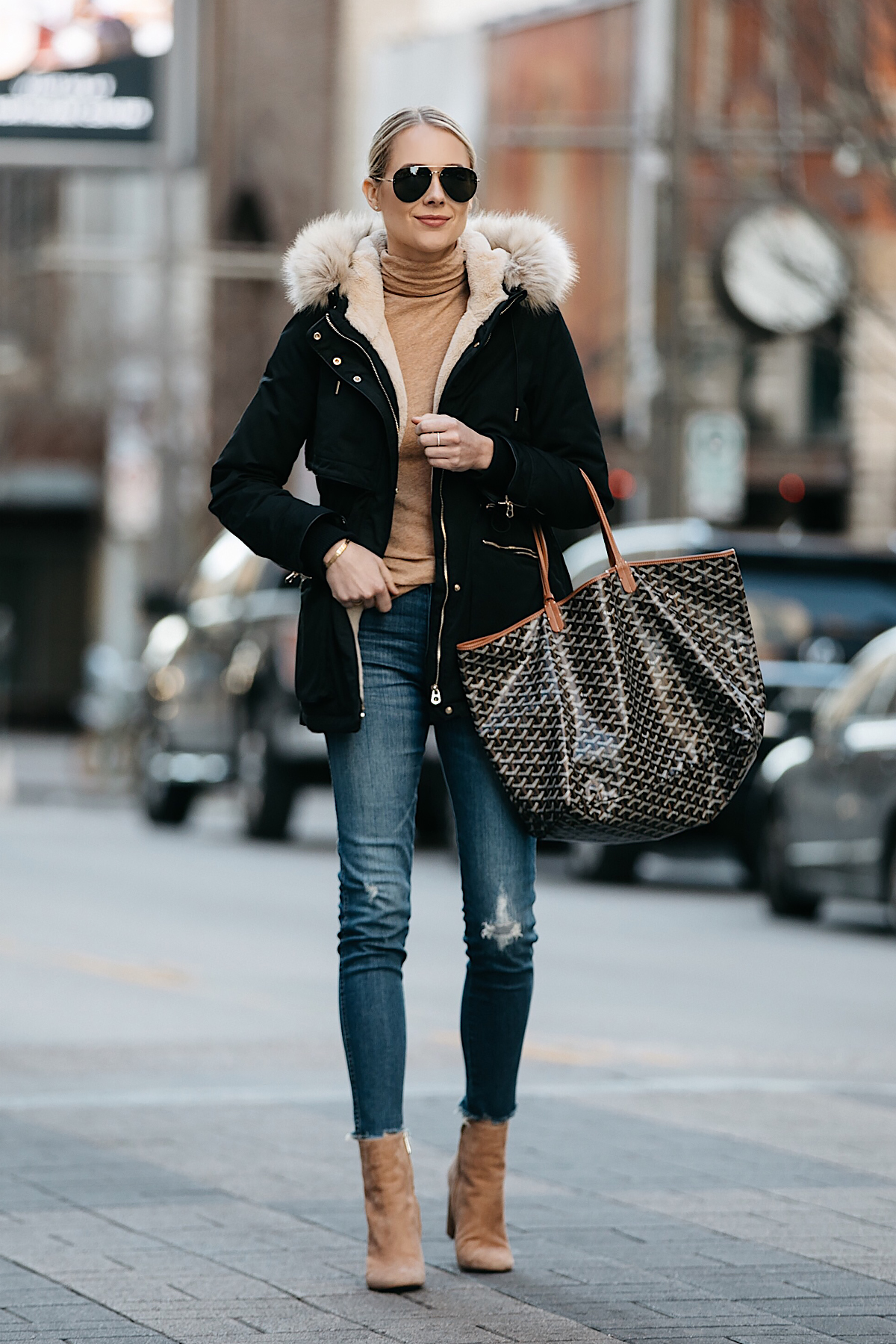 Blonde Woman Wearing Zara Faux Fur Trimmed Black Parka Jacket Goyard Tote Denim Jeans Tan Turtleneck Sam Edelman Corra Booties Fashion Jackson Dallas Blogger Fashion Blogger Street Style