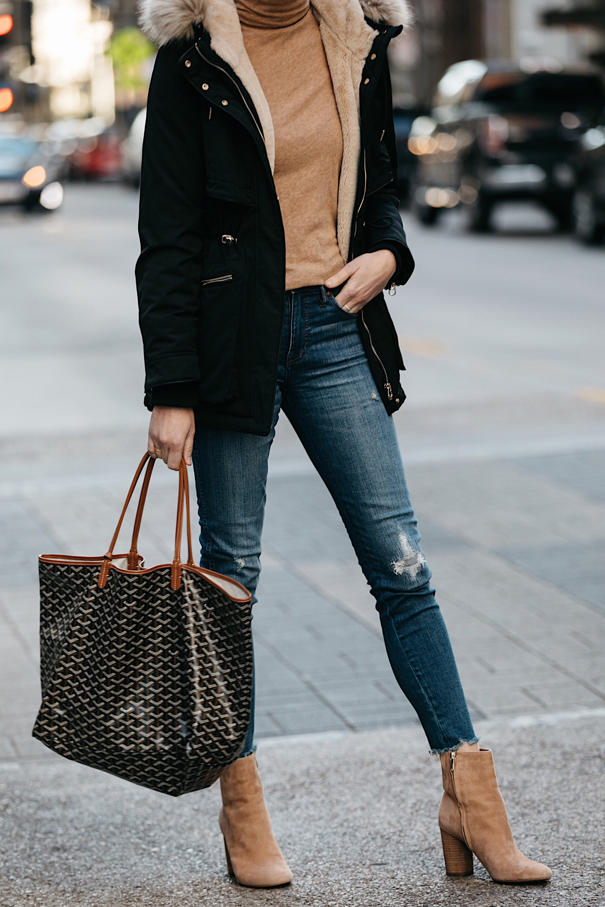 Woman Wearing Zara Faux Fur Trimmed Black Parka Jacket Goyard Tote Denim Jeans Tan Turtleneck Sam Edelman Corra Booties Fashion Jackson Dallas Blogger Fashion Blogger Street Style