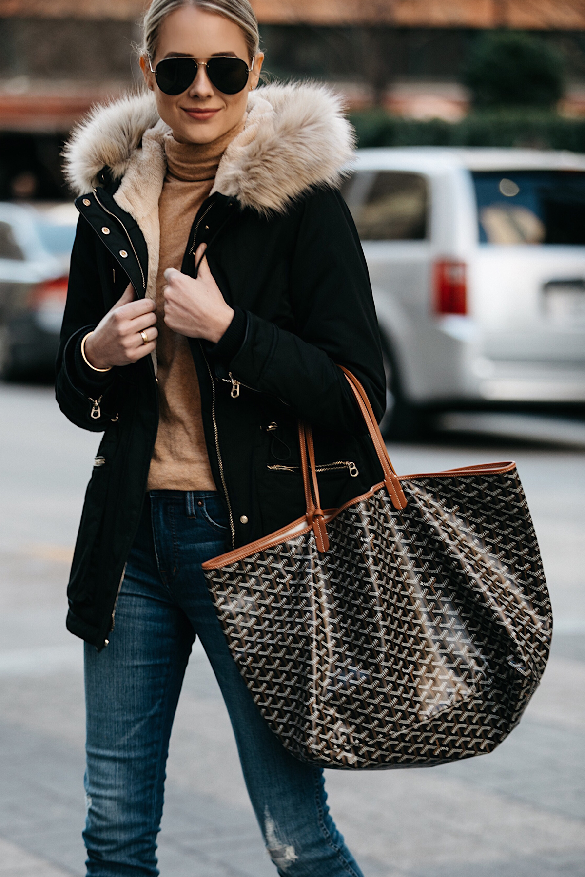 Blonde Woman Wearing Zara Faux Fur Trimmed Black Parka Jacket Goyard Tote Denim Jeans Tan Turtleneck Fashion Jackson Dallas Blogger Fashion Blogger Street Style