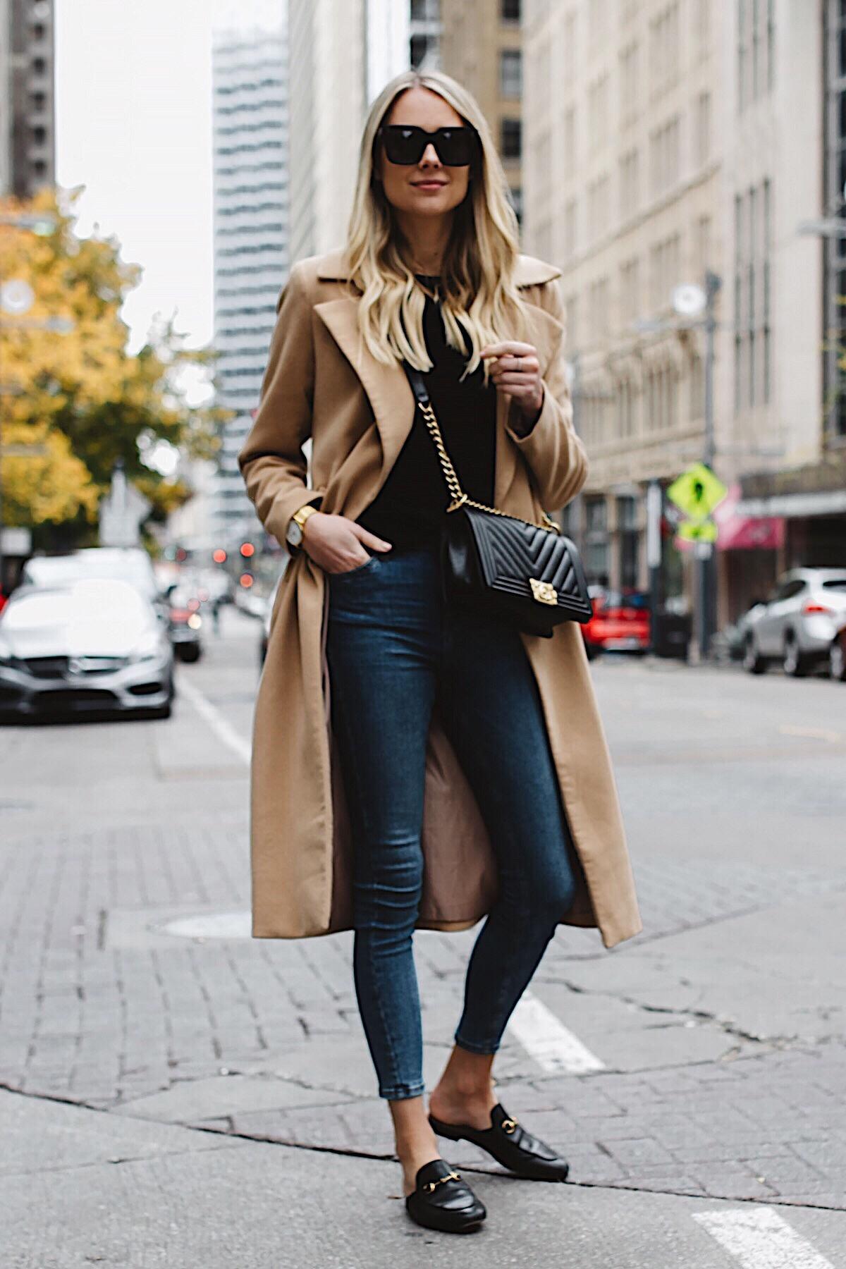 Blonde Woman Wearing Long Camel Coat Black Sweater Topshop Denim Skinny Jeans Gucci Mules Chanel